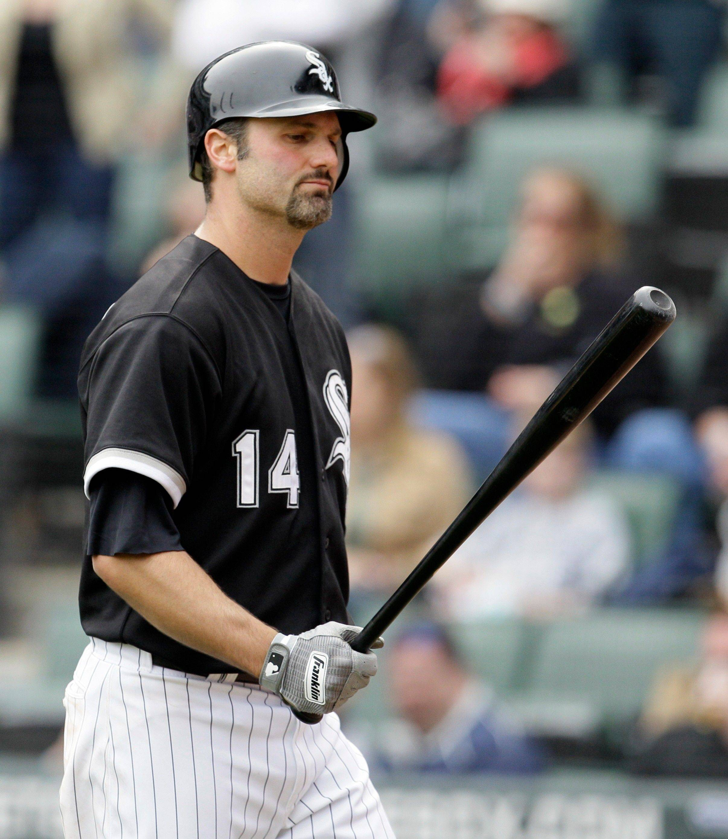 The White Sox' Paul Konerko is called out on strikes in the ninth inning Sunday.
