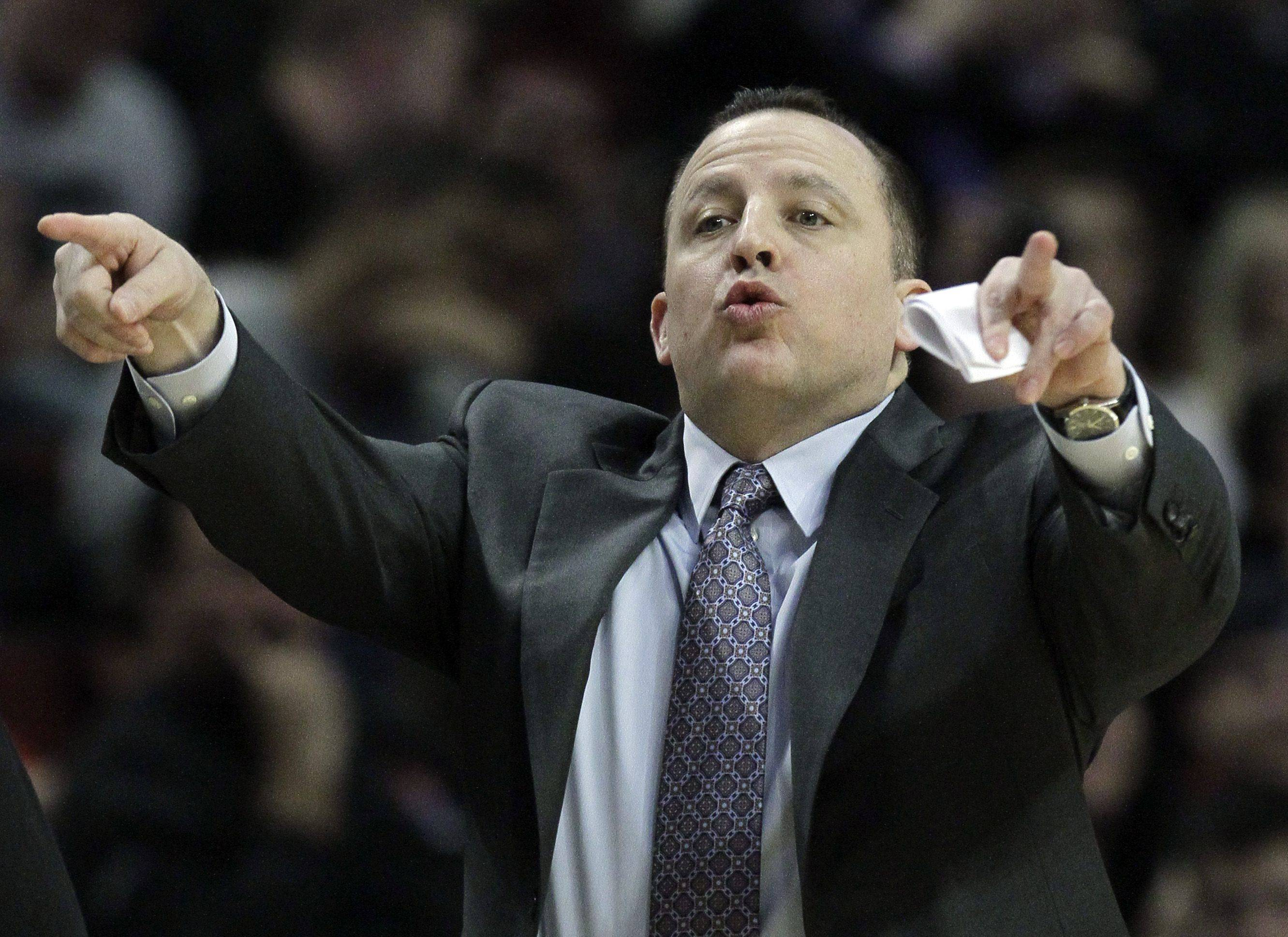 Tom Thibodeau signals to his team during a game against the Orlando Magic.