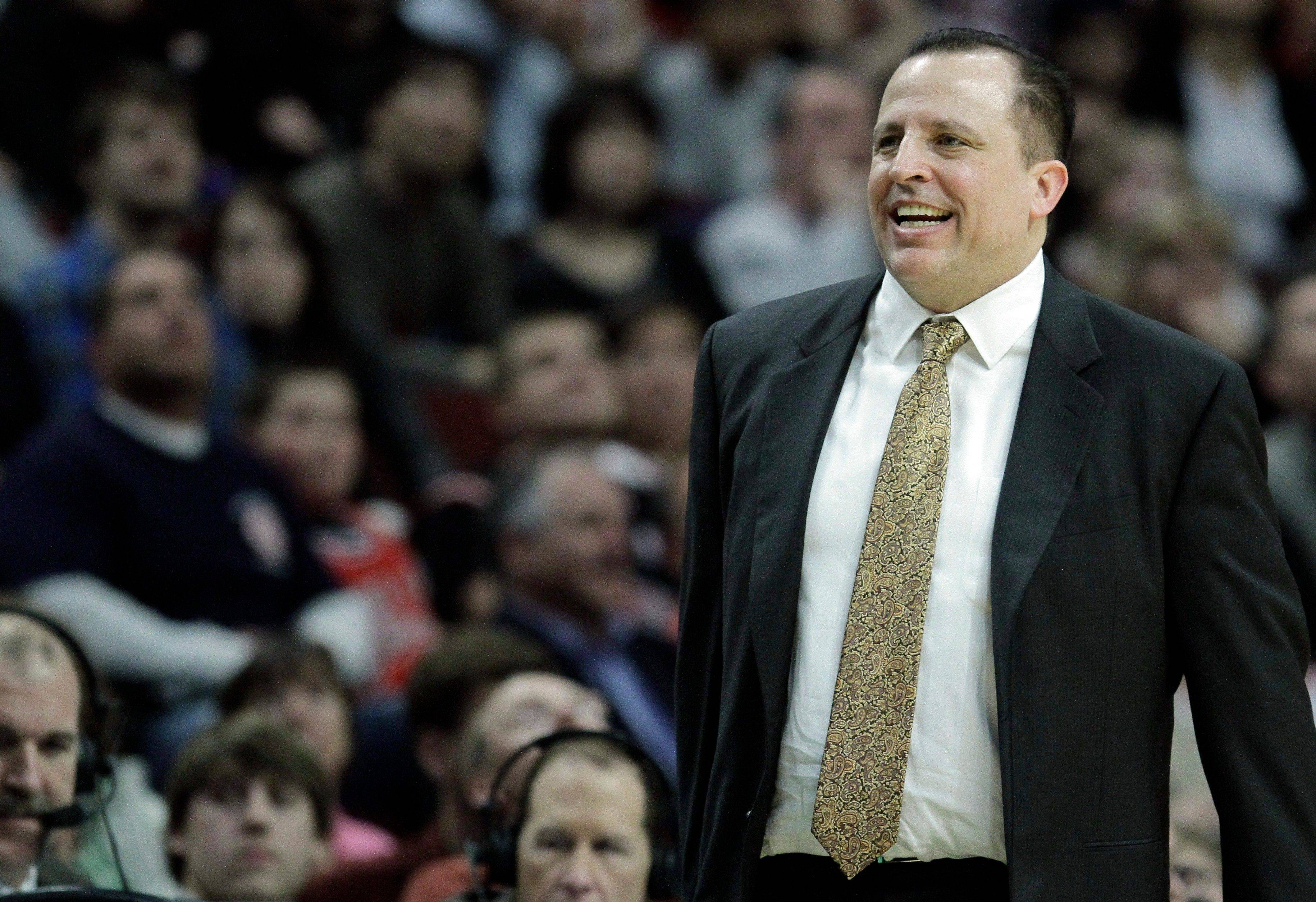 Tom Thibodeau smiles as he watches his team play against the New Jersey Nets.