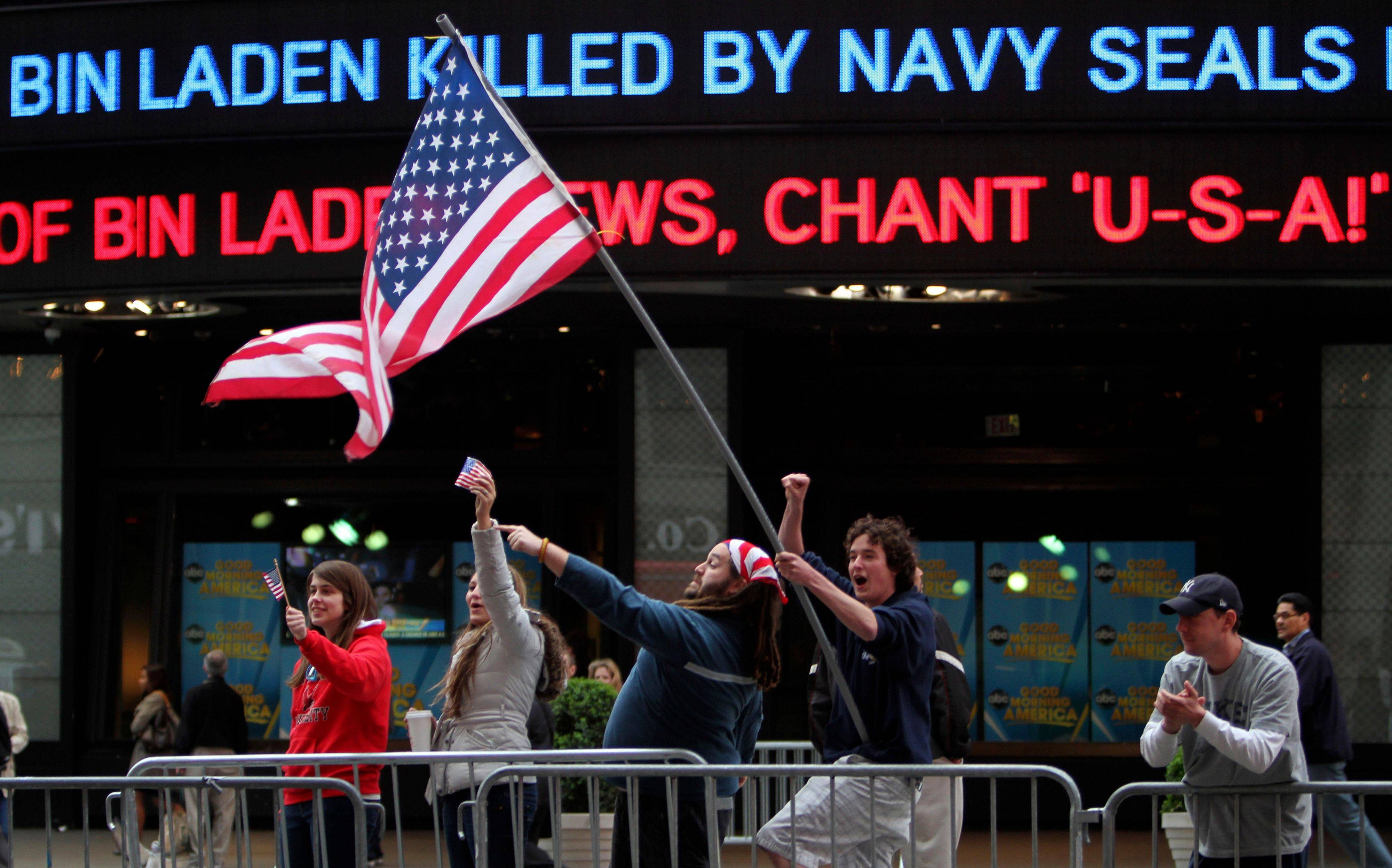 In the early morning after President Barack Obama's announcement that our troops had killed Osama bin Laden, Melissa LaCour, from left, Brittany McGarry, Bryan Murray and Dennis Vincent celebrate in New York's Times Square.