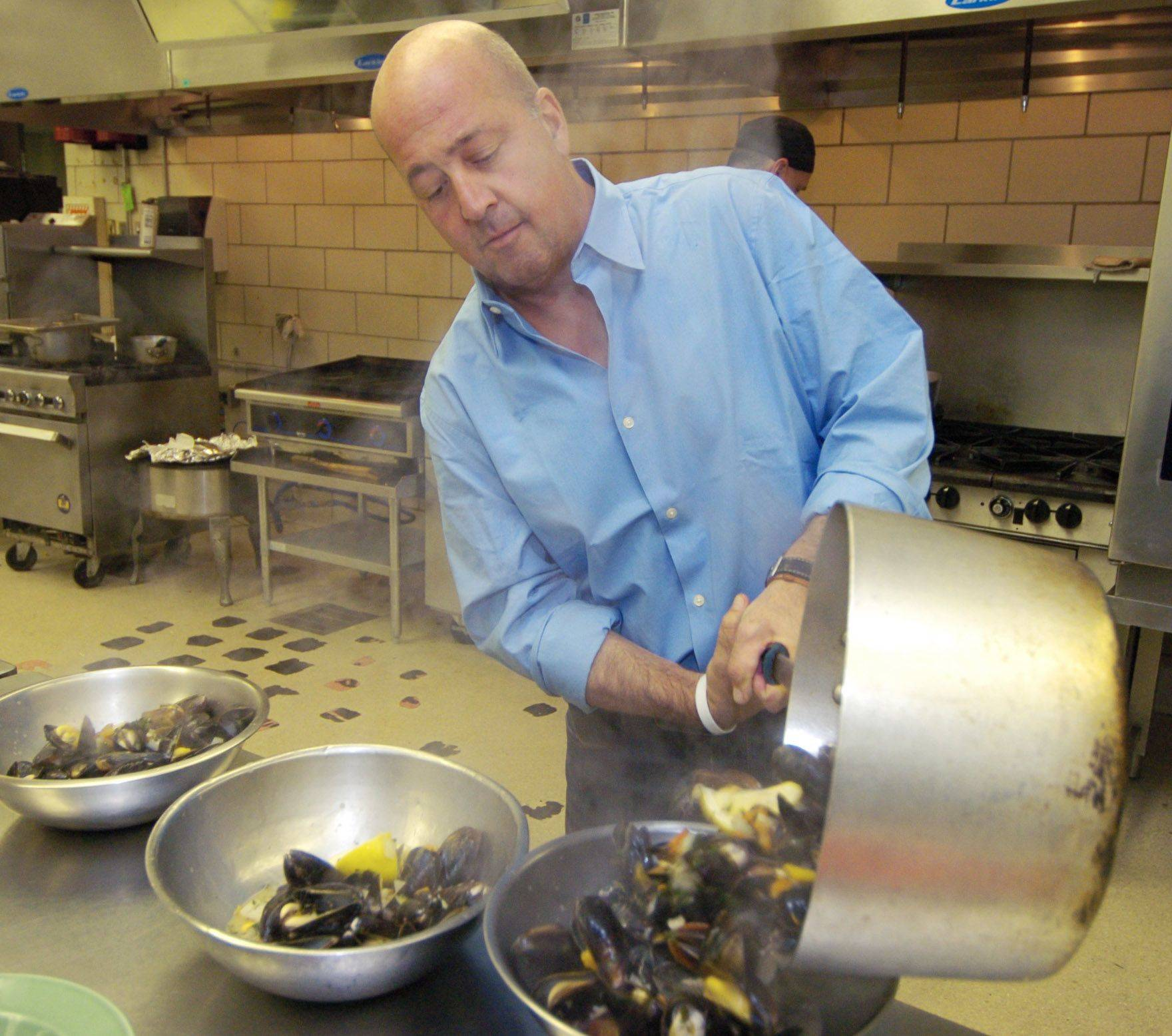 "Andrew Zimmern, host of Travel Channel's ""Bizarre Foods"" and ""Bizarre World,"" cooked mussels for students in Harper College's culinary program during his recent visit to the Palatine campus."