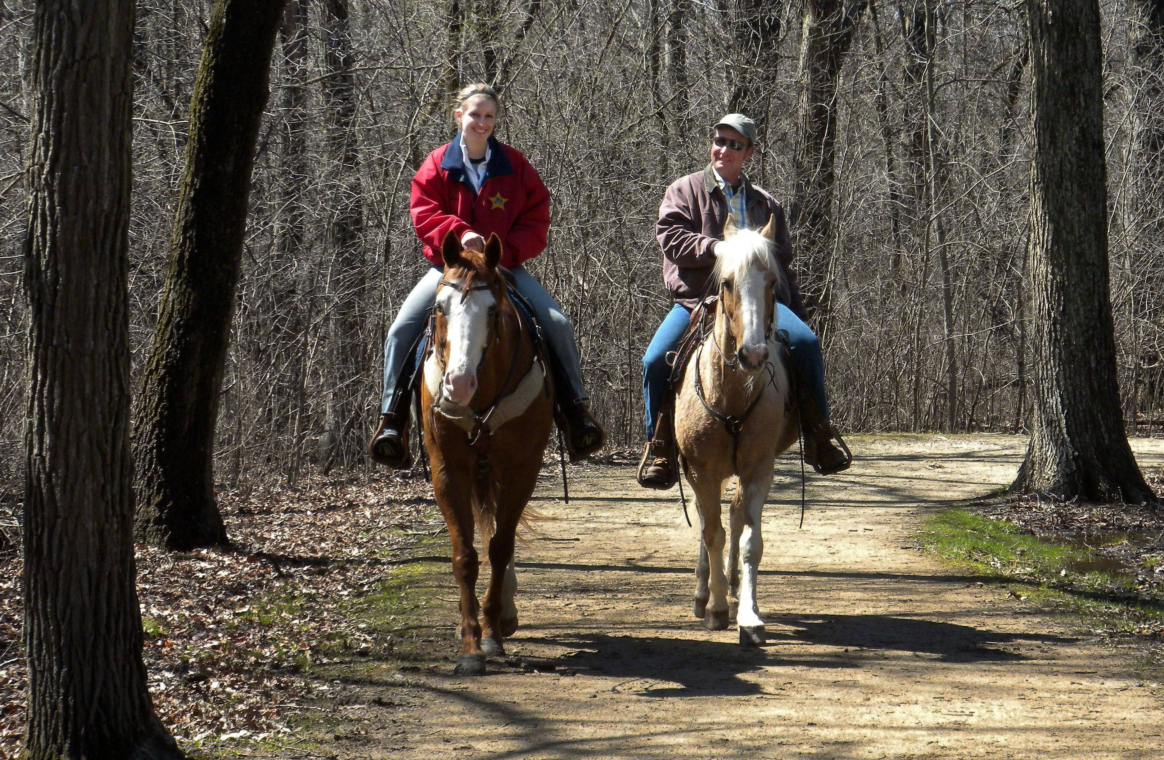 Brittany Wancho, 20, and her father, Don, of Lindenhurst enjoy a morning ride with the Lake County Mounted Posse over the weekend at Old School Forest Preserve near Libertyville. The Posse is a horse club based in Lake County with members from northeastern Illinois and southeastern Wisconsin who participate in monthly rides.