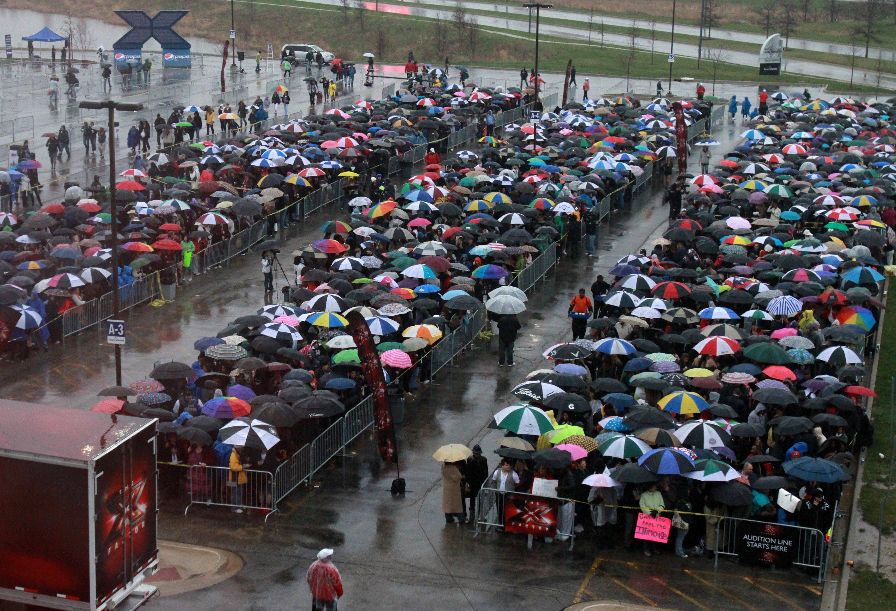 Thousands of suburban hopefuls stand in line in the rain to try out for Simon Cowell's new show, The X Factor, at the Sears Centre in Hoffman Estates Wednesday.