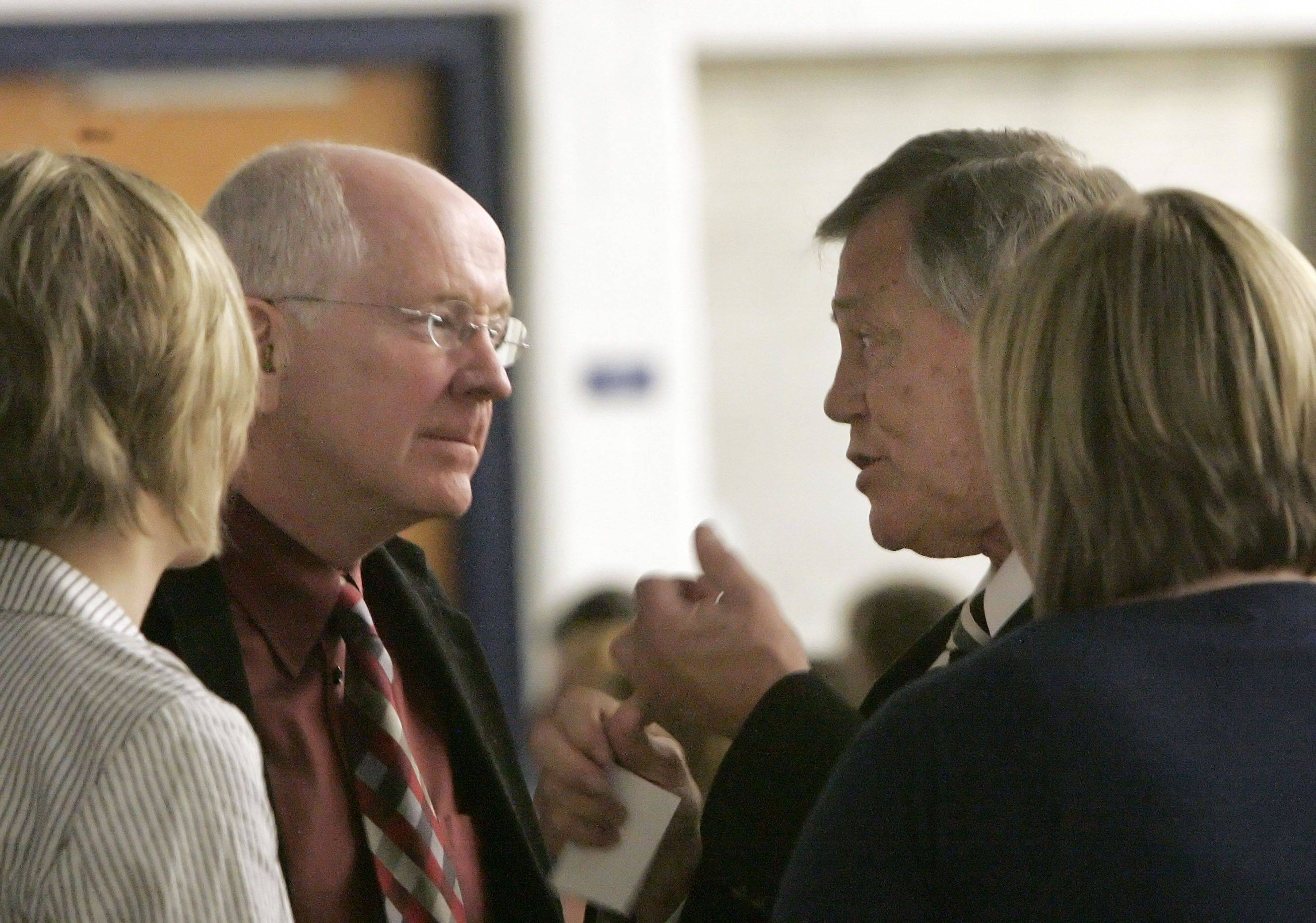 Minneapolis Psychologist Dr. David Walsh, left, and Bart Teal, founder of Blue Ribbon Schools of Excellence Inc. in South Carolina, talk during a conference at Grayslake Elementary District 46's Park Campus Friday.