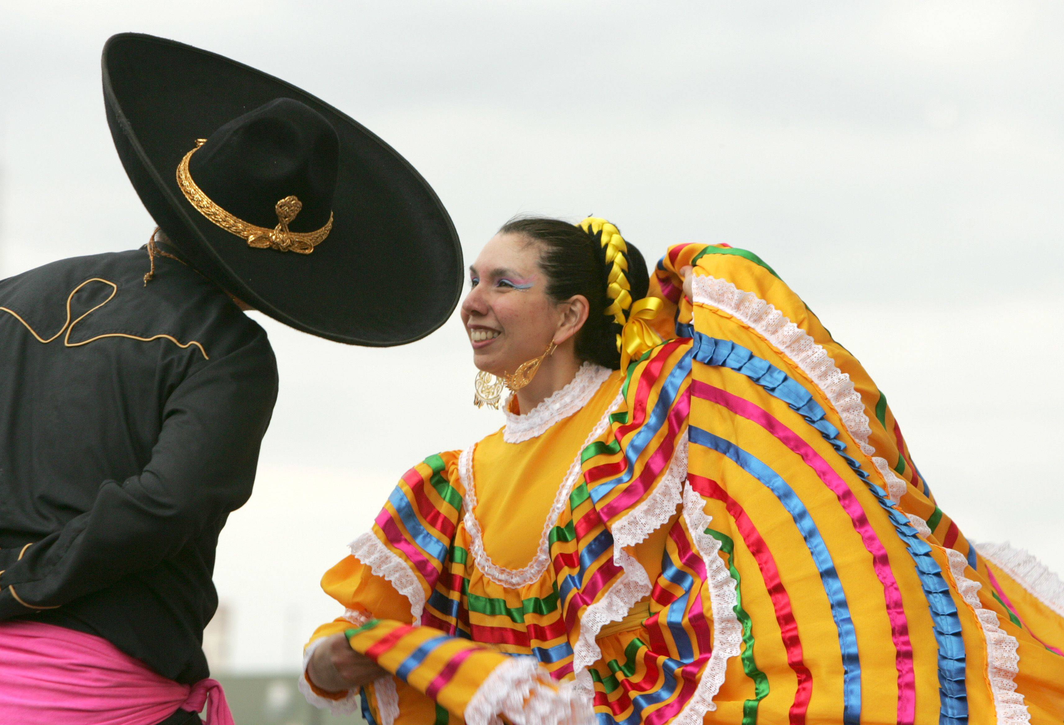 Aracely Gomez of the Ballet Folklorico Quetzalcoatl dances during the Aurora School Districts' El Dia De Los Ninos, or childrens day, held at the Aurora Transportation Center.
