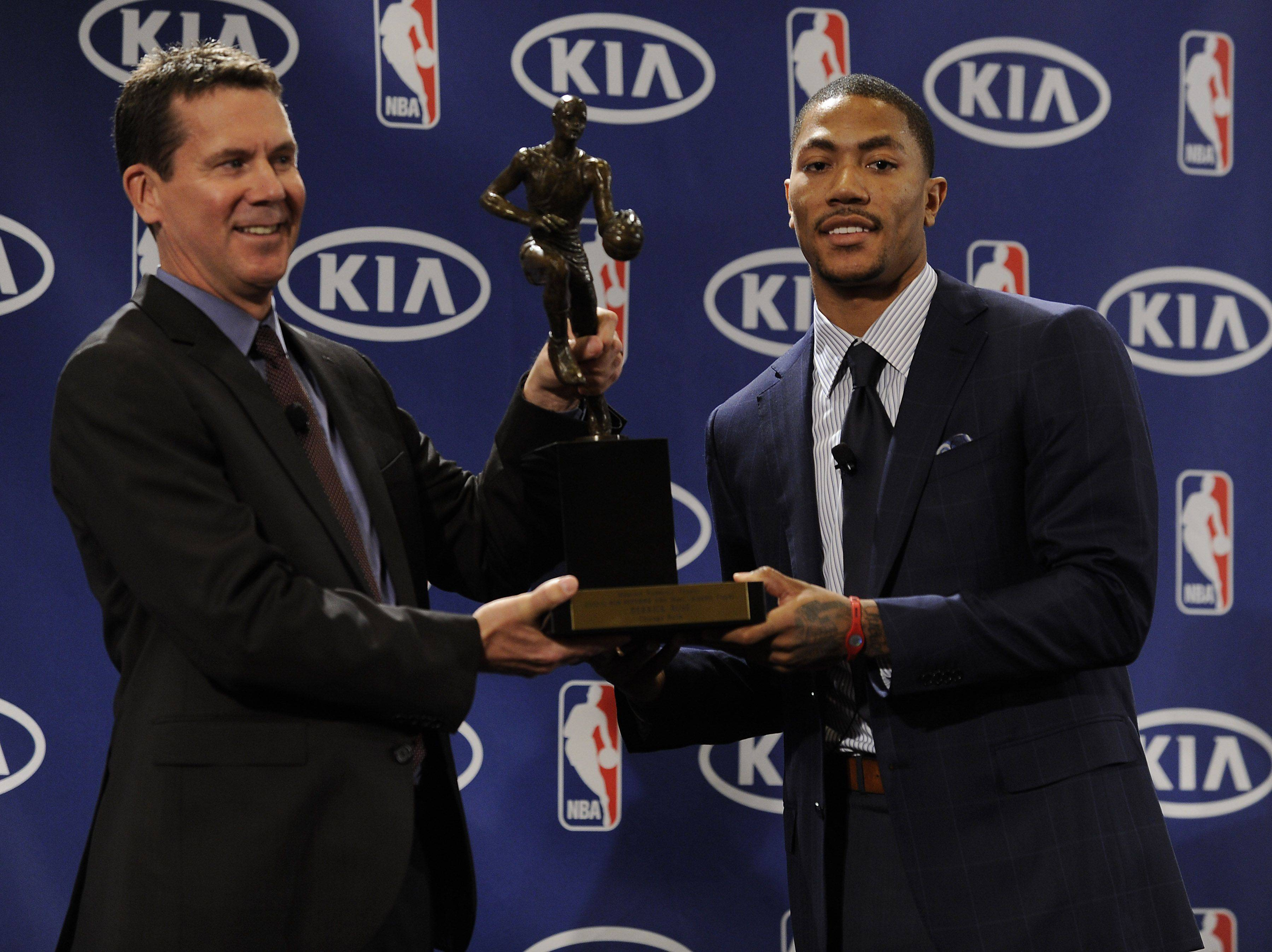 Derrick Rose with Tim Chaney, Director of Marketing at KIA Motors America.