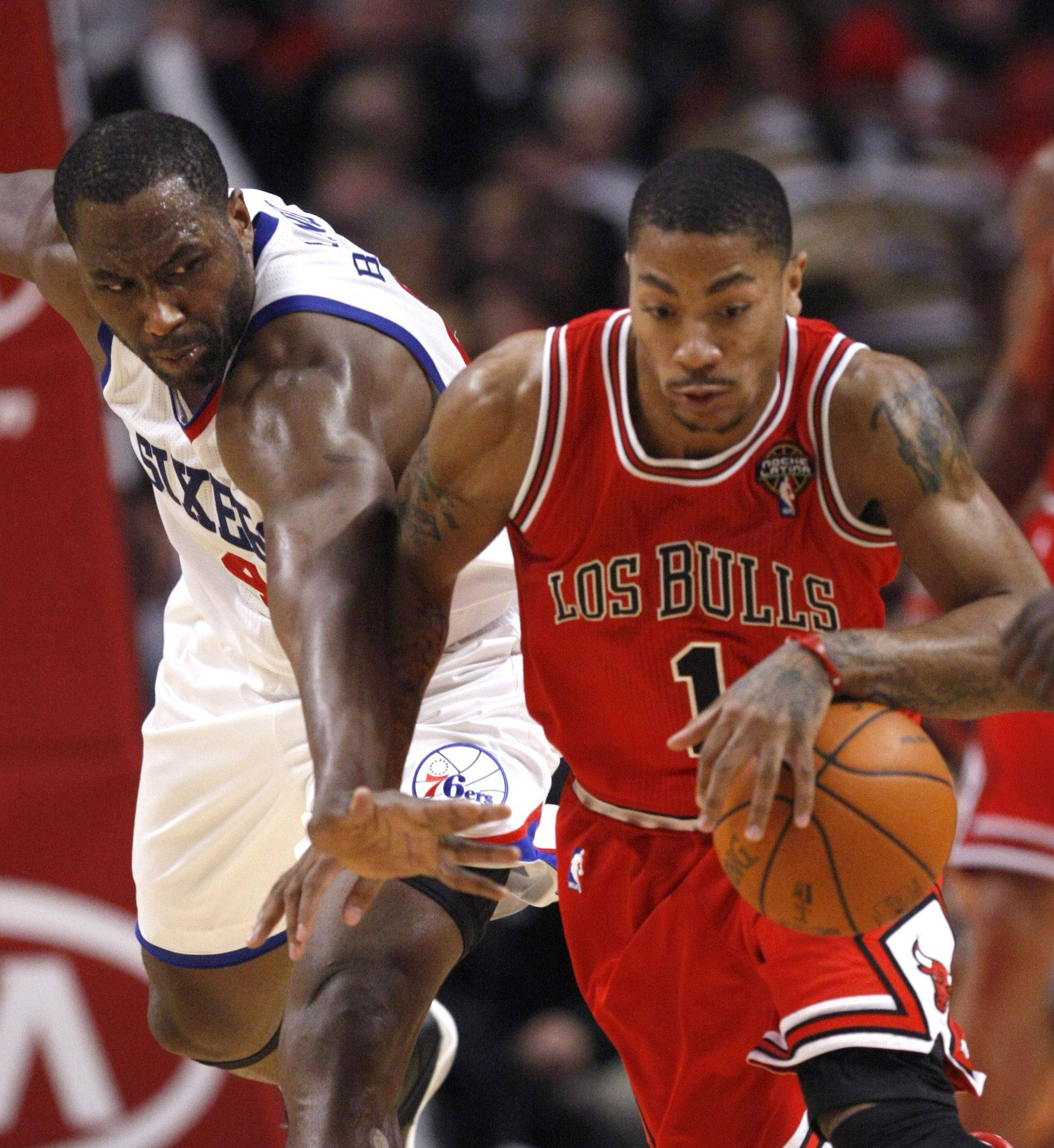 Philadelphia 76ers forward Elton Brand, left, challenges Chicago Bulls guard Derrick Rose during the second half of an NBA basketball game, Monday, March 28, 2011, in Chicago. The 76ers won 97-85.