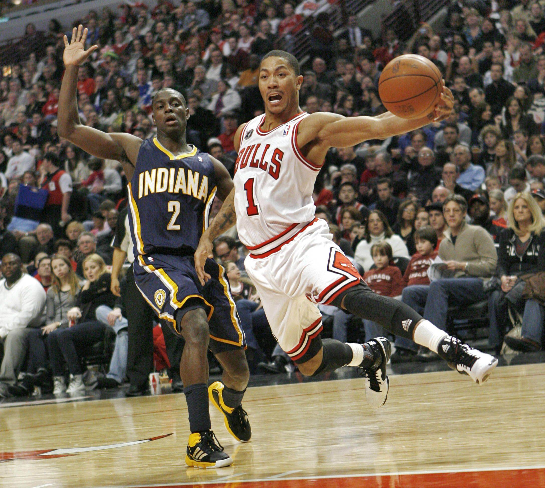 The Chicago Bulls' Derrick Rose (1) loses control of ball as he drives around Indiana Pacers' Darren Collison in the fourth quarter as the Bulls defeated the Pacers 110-89 in an NBA basketball game in Chicago on Saturday, Jan. 29, 2011.