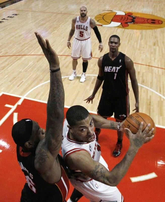 Chicago Bulls Guard Derrick Rose Right Looks For A Shot Against Miami Heat Forward