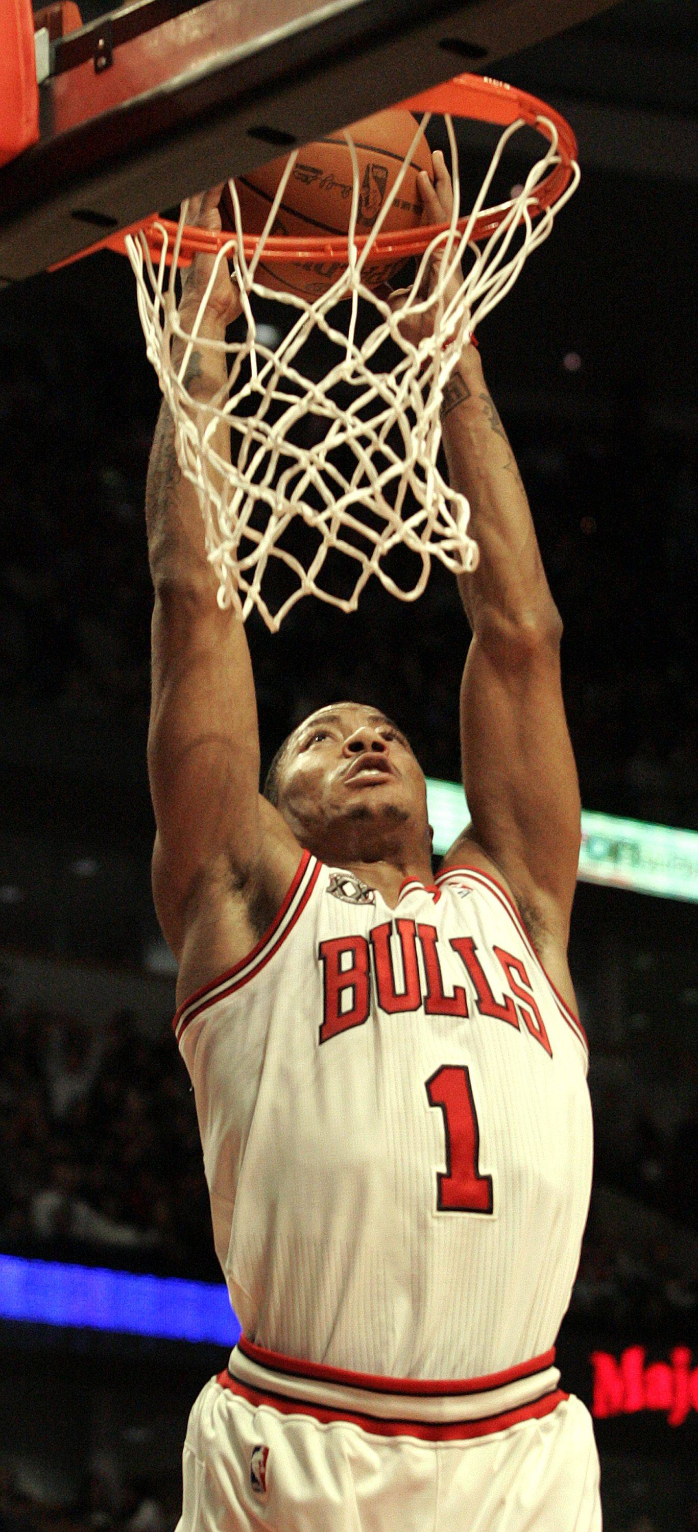 Chicago Bulls' Derrick Rose jams a shot against the Detroit Pistons during the second half of an NBA basketball game Monday, Jan. 10, 2011 in Chicago.