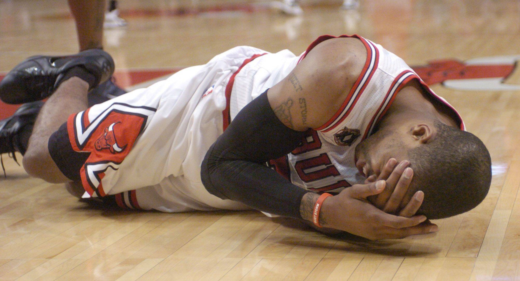 The Bulls' C.J. Watson lays on the floor after drawing contact under the basket Monday.