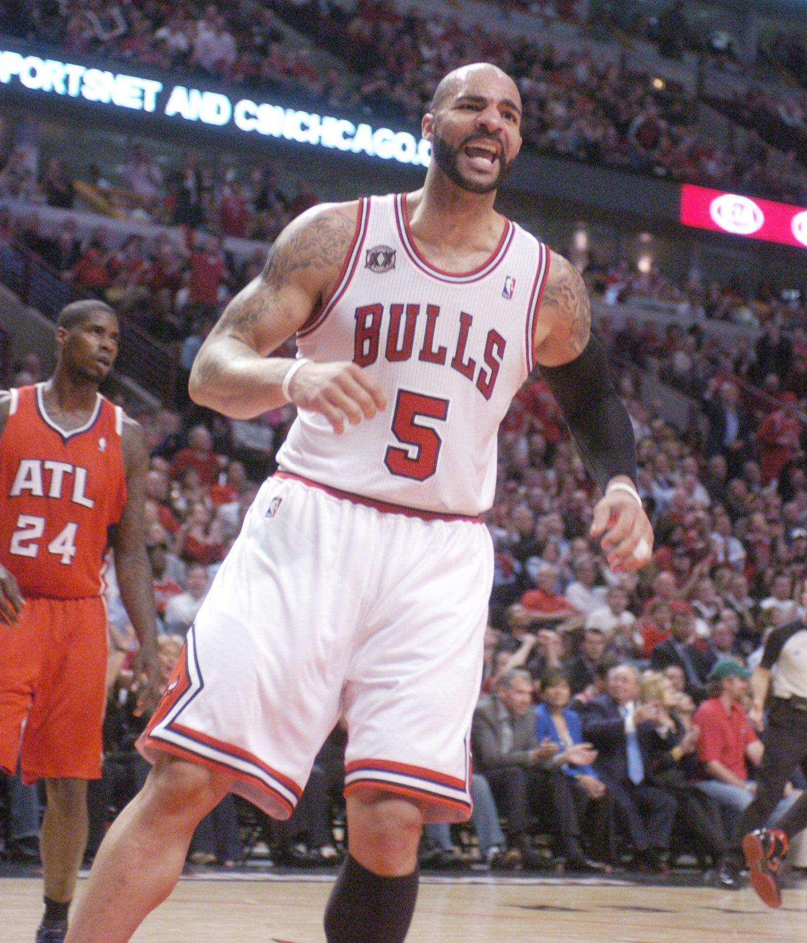 Chicago's Carlos Boozer celebrates after scoring in the closing seconds of the first half against the Atlanta Hawks Monday.