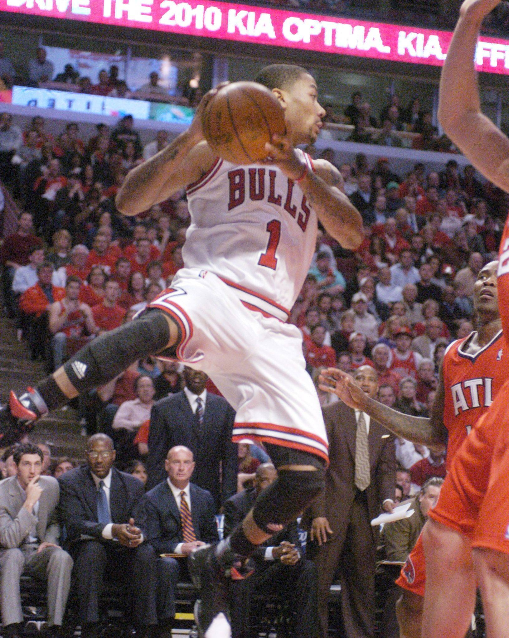 Derrick Rose passes in midair along the baseline Monday.