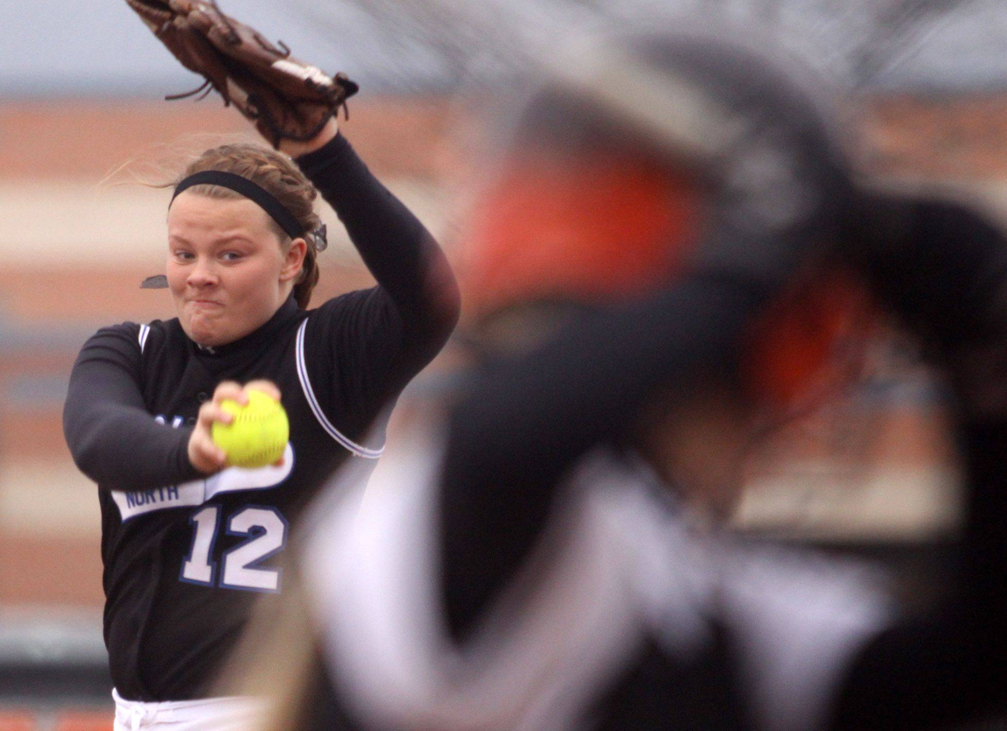 St. Charles North hurler Amanda Ciran bears down on an opposing batter at St. Charles East Monday afternoon.