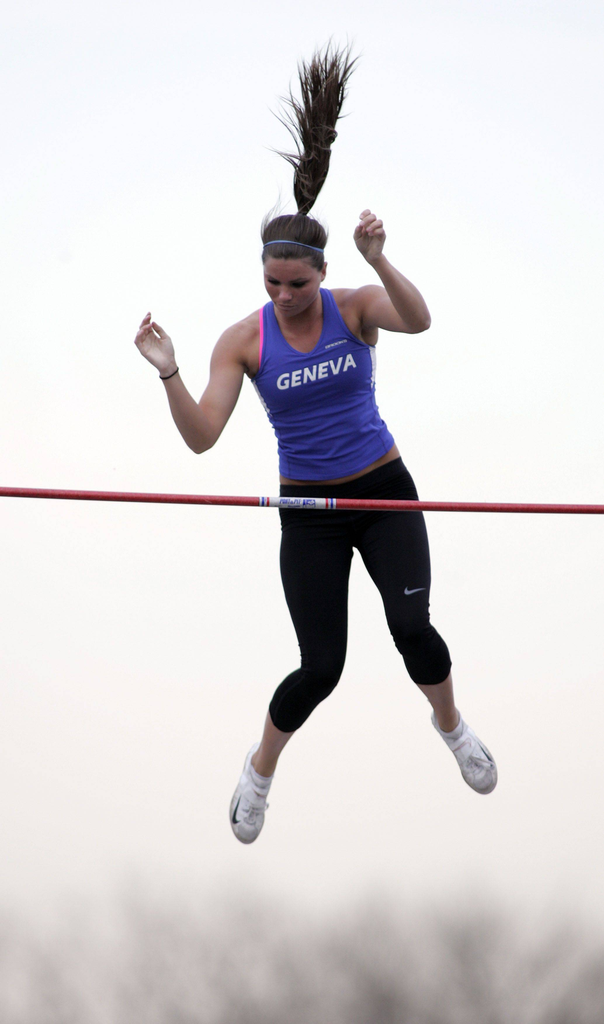 Erin Kluck of Geneva clears the bar in the pole vault during the Girls Kane County Invitational Track and Field Meet Friday.