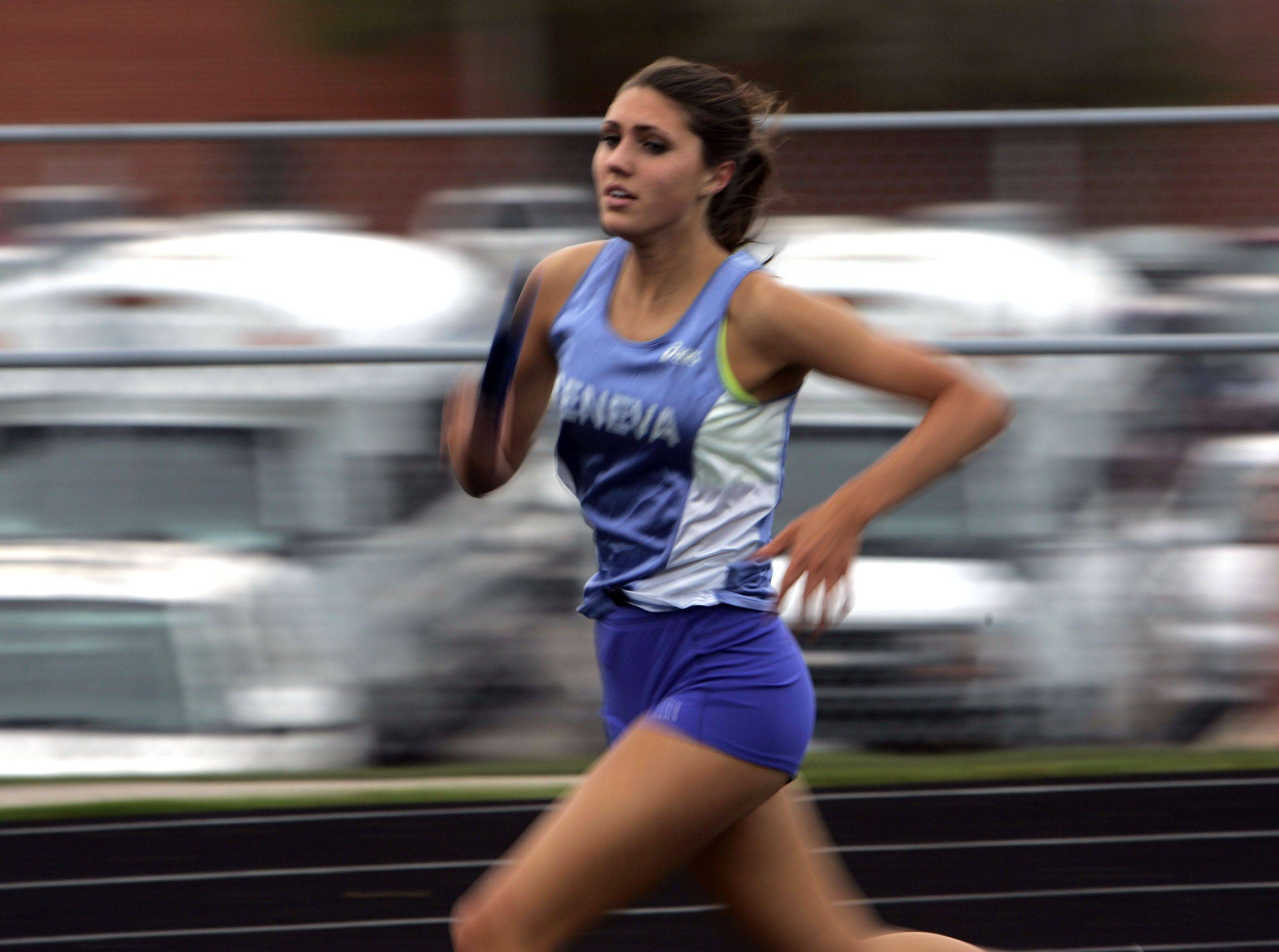 Liza Tauscher of Geneva in the 4x800 meter relay during the Girls Kane County Invitational Track and Field Meet Friday.