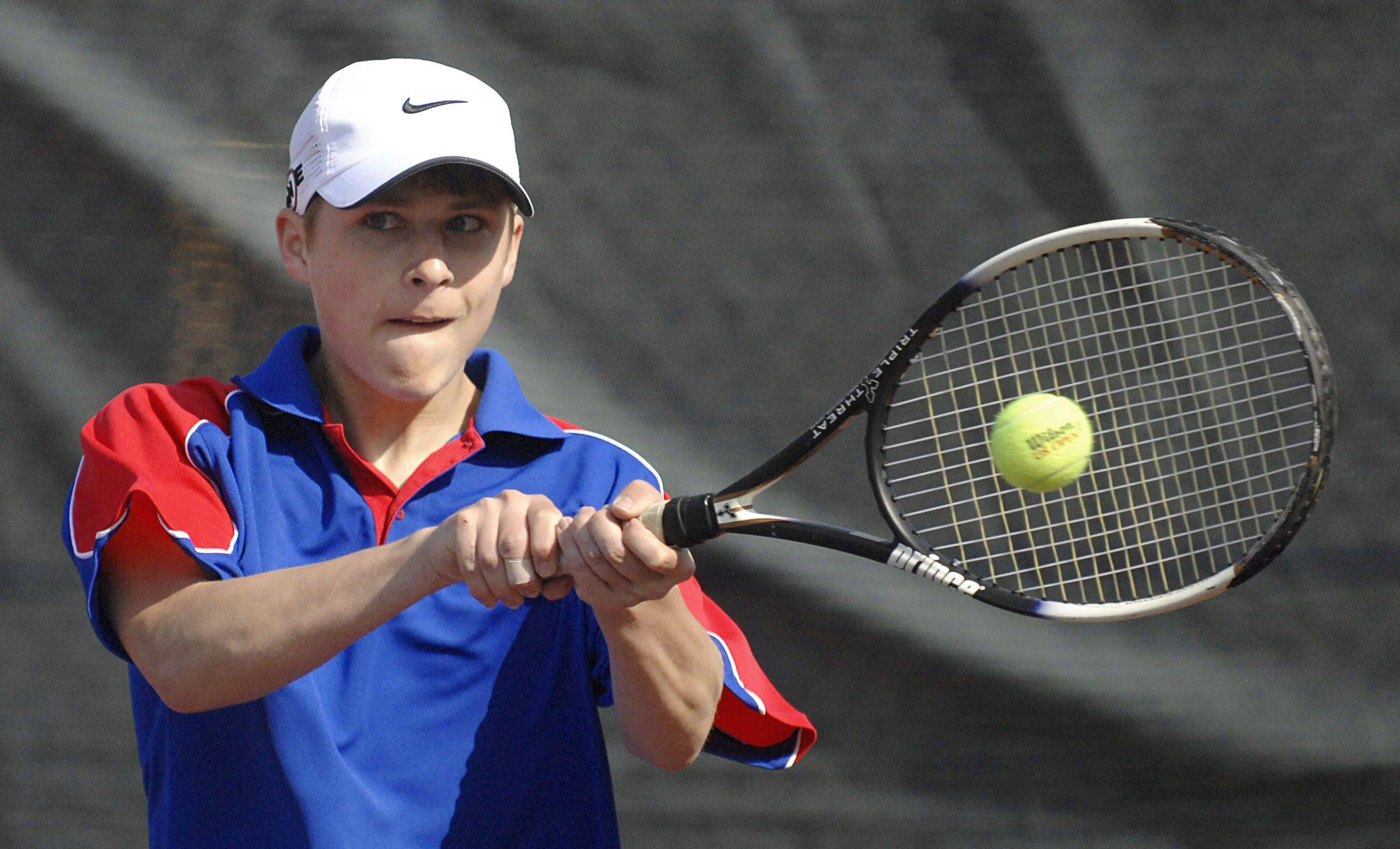 Marmion's Kevin Hoss returns a shot in his first singles match against West Aurora's Luke Frauenhoff Saturday.