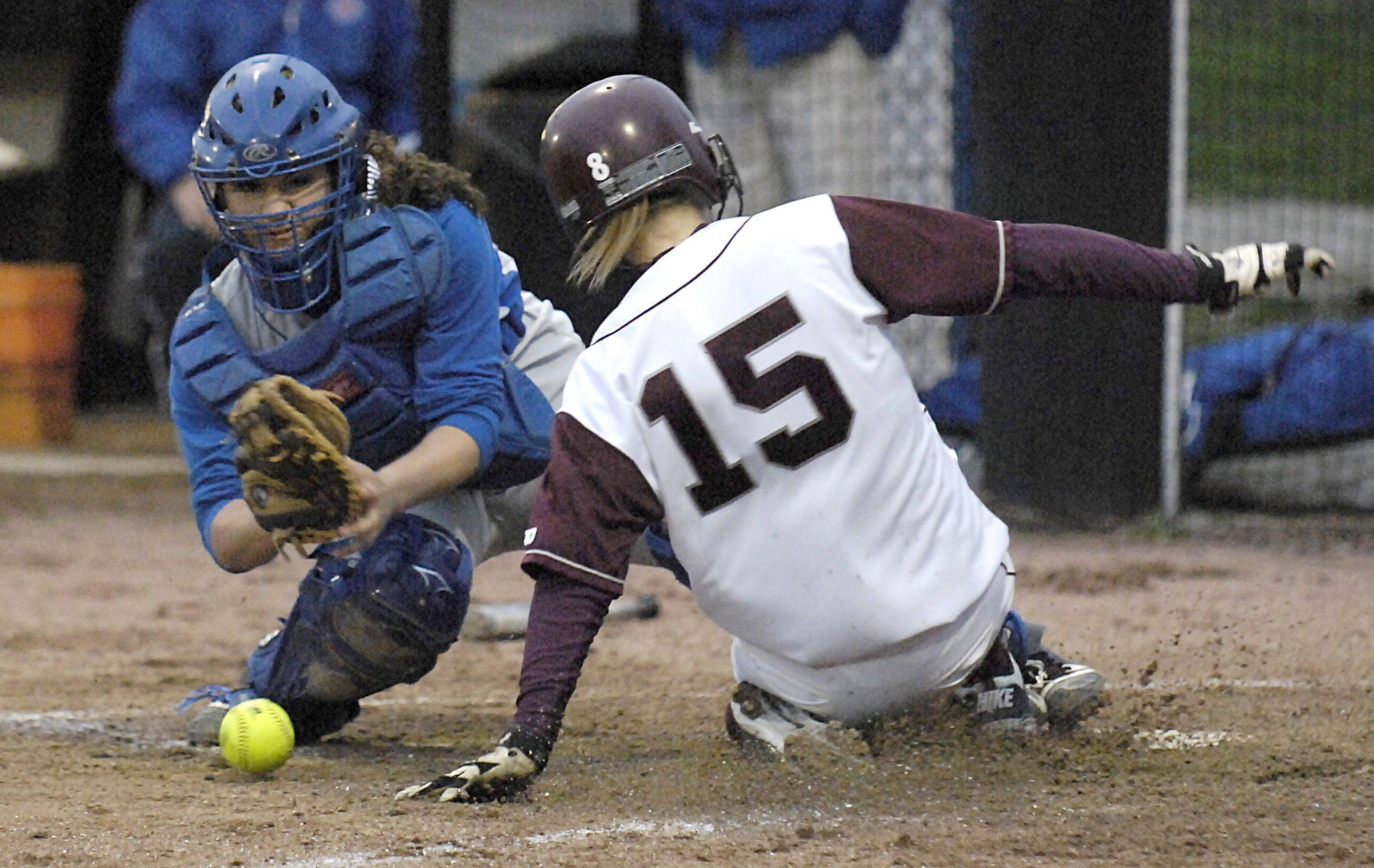 Elgin's Monica Stockman is safe at home plate from Larkin's Alex Buhrow in the second inning on Wednesday.