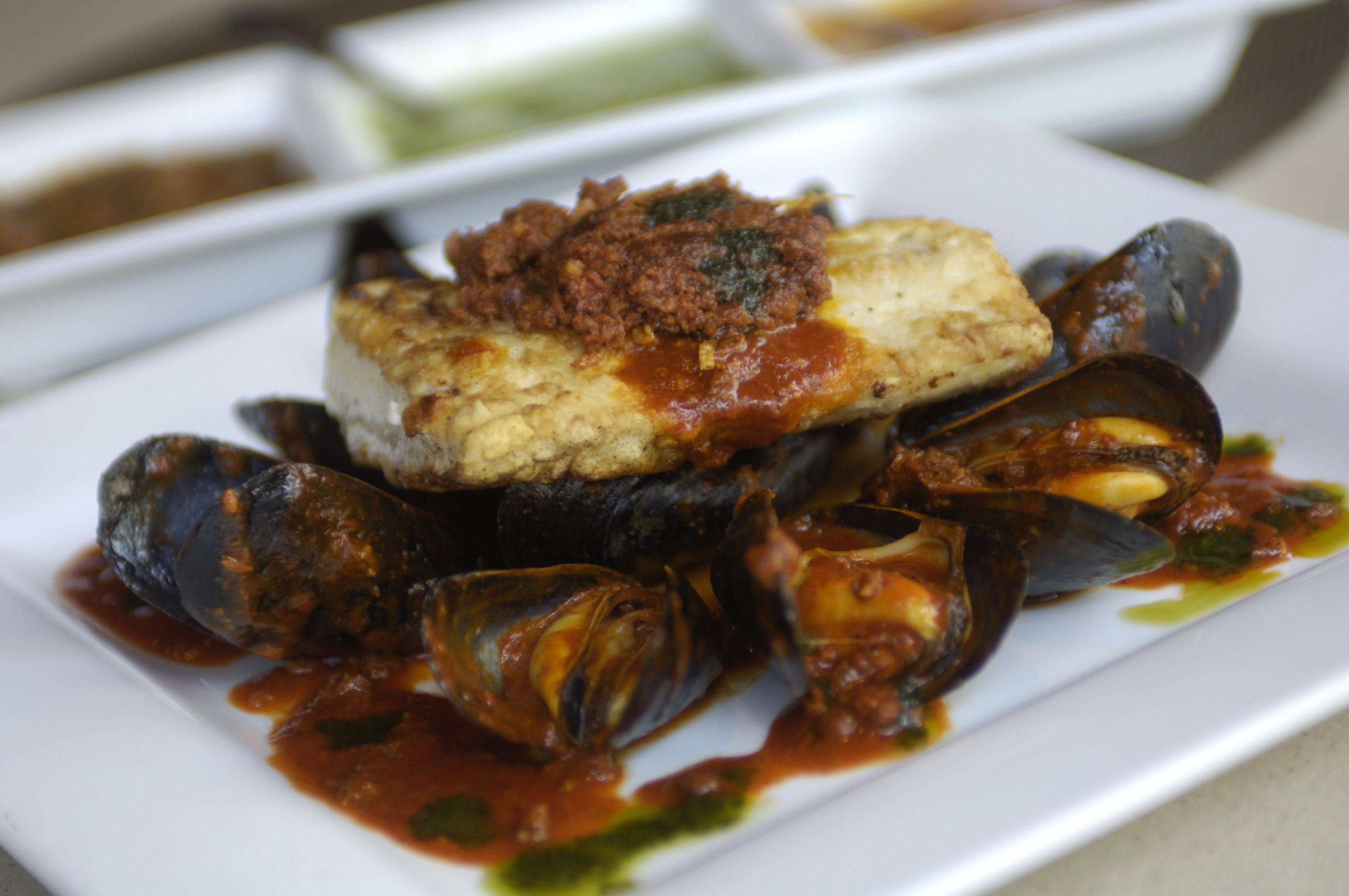 JOE LEWNARD/jlewnard@dailyherald.com Chorizo with mussels and seabass at Mago restaurant, Arlington Heights.