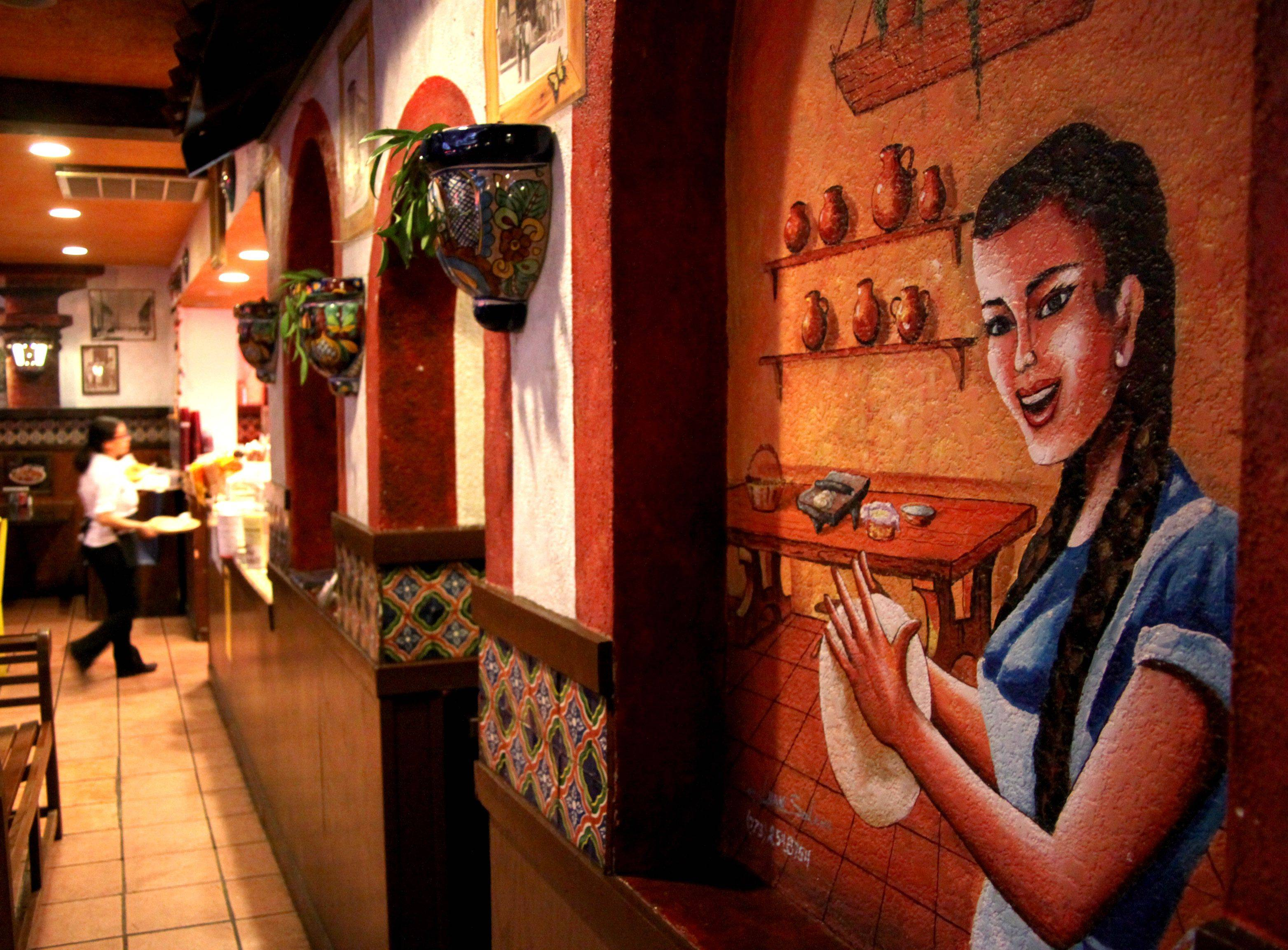 Murals and decor add to the flair at El Faro restaurant in Bartlett .