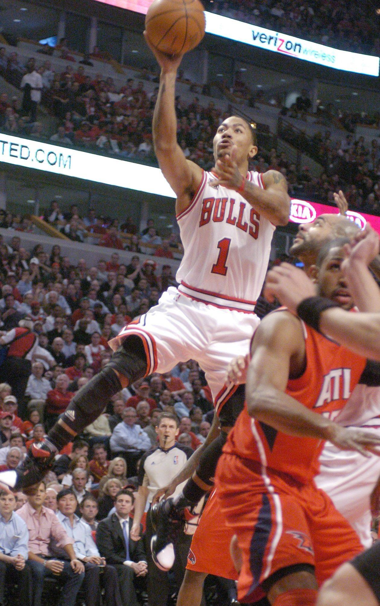 NBA MVP Derrick Rose makes a running, one-handed jump shot against the Hawks Wednesday.