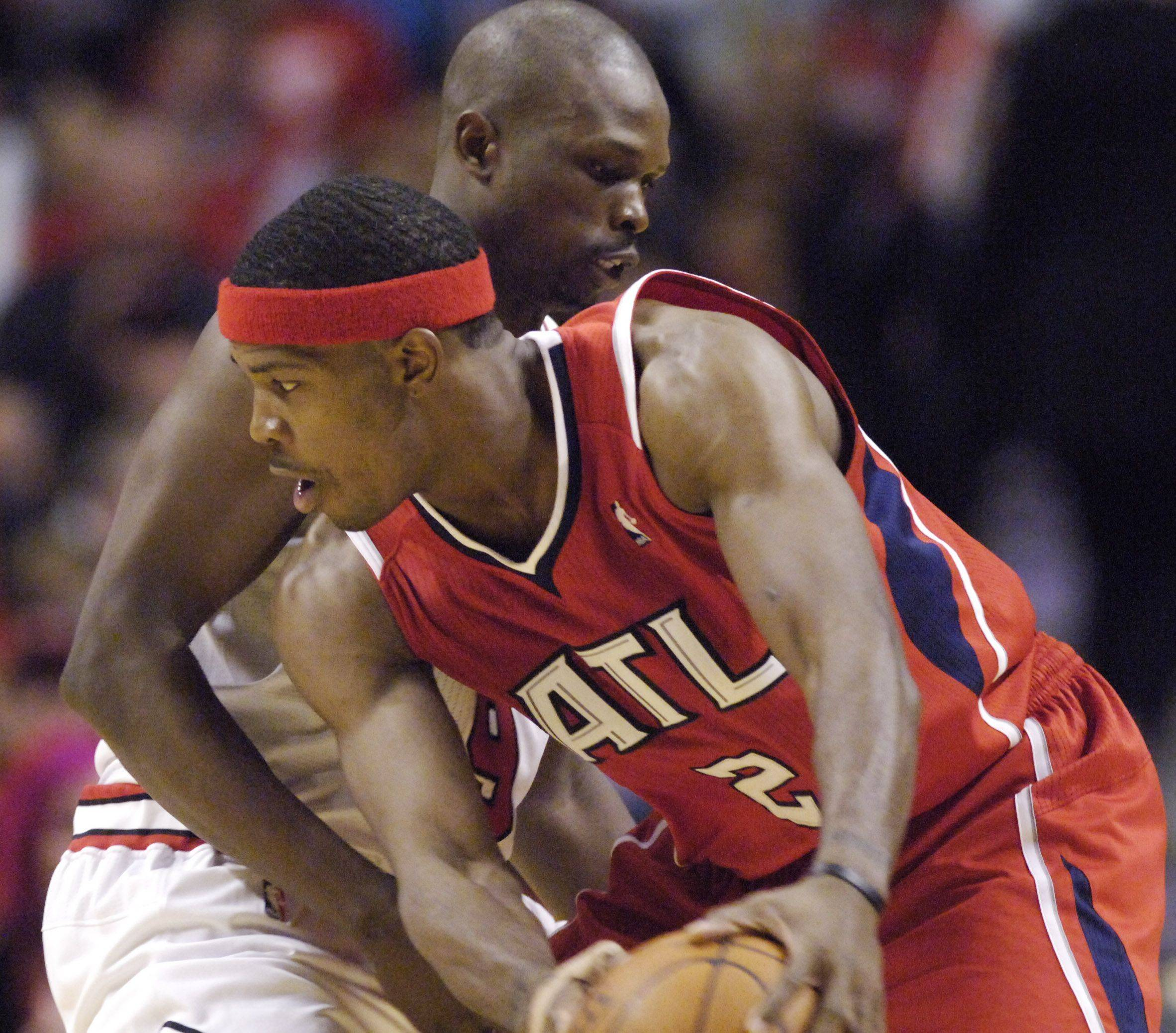 The Hawks' Joe Johnson tries to get around Luol Deng of the Bulls.