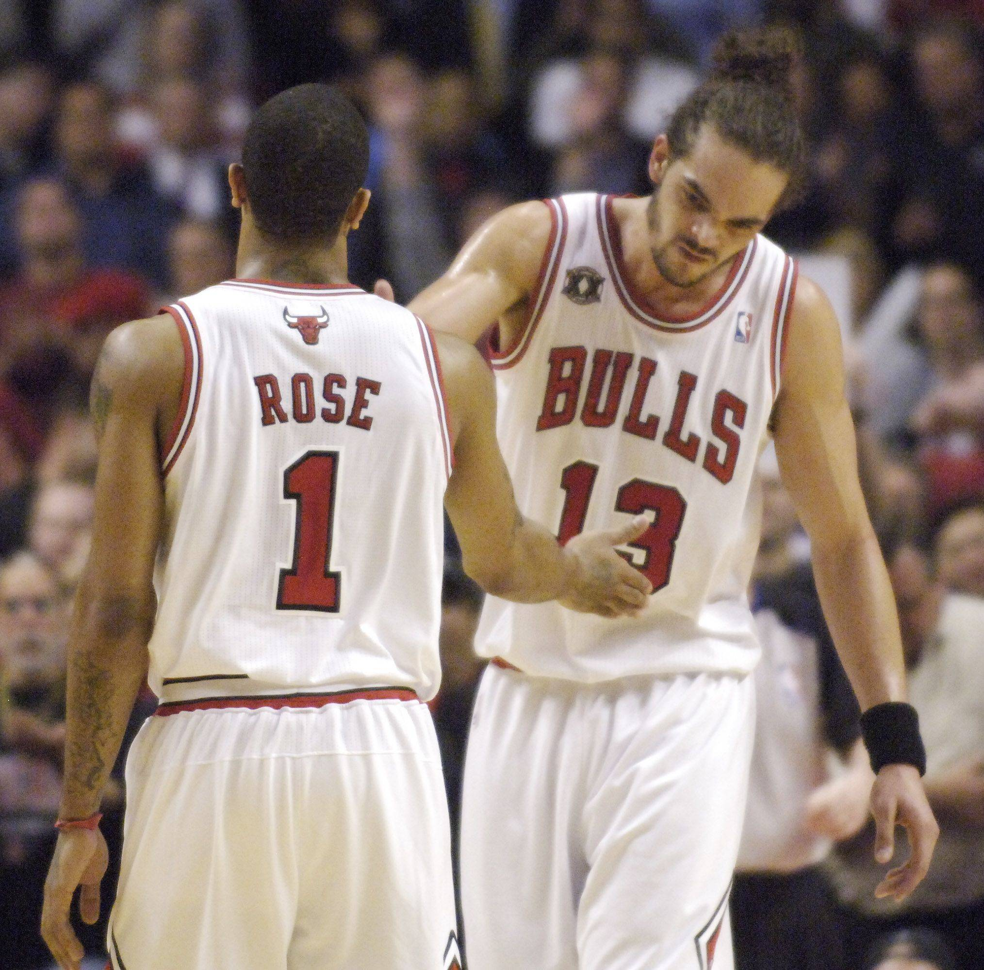 Bulls teammates Derrick Rose and Joakim Noah congratulate one another at the end of Wednesday's victory over the Hawks.
