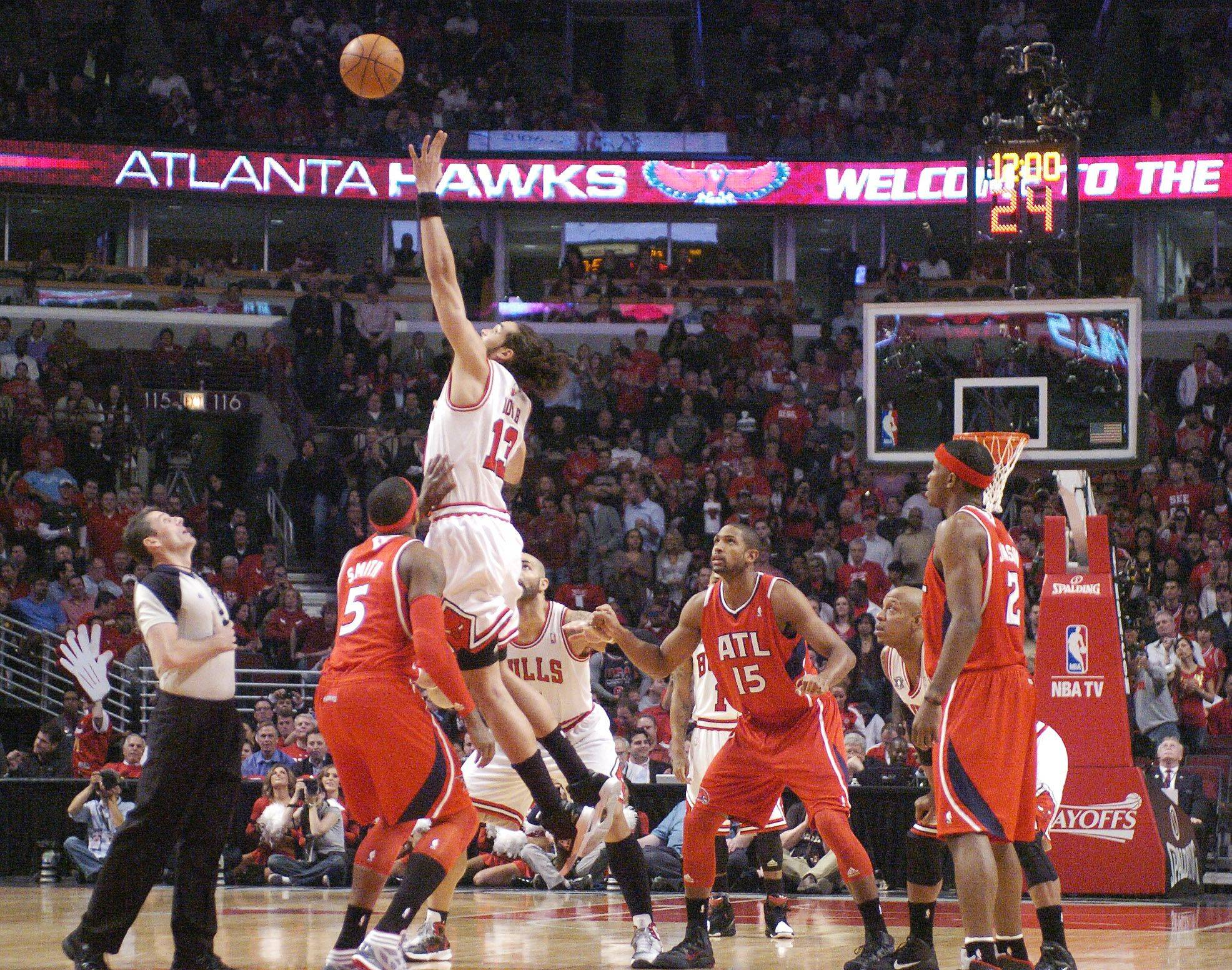Joakim Noah of the Bulls leaps for the opening tip during Wednesday's game against the Hawks.