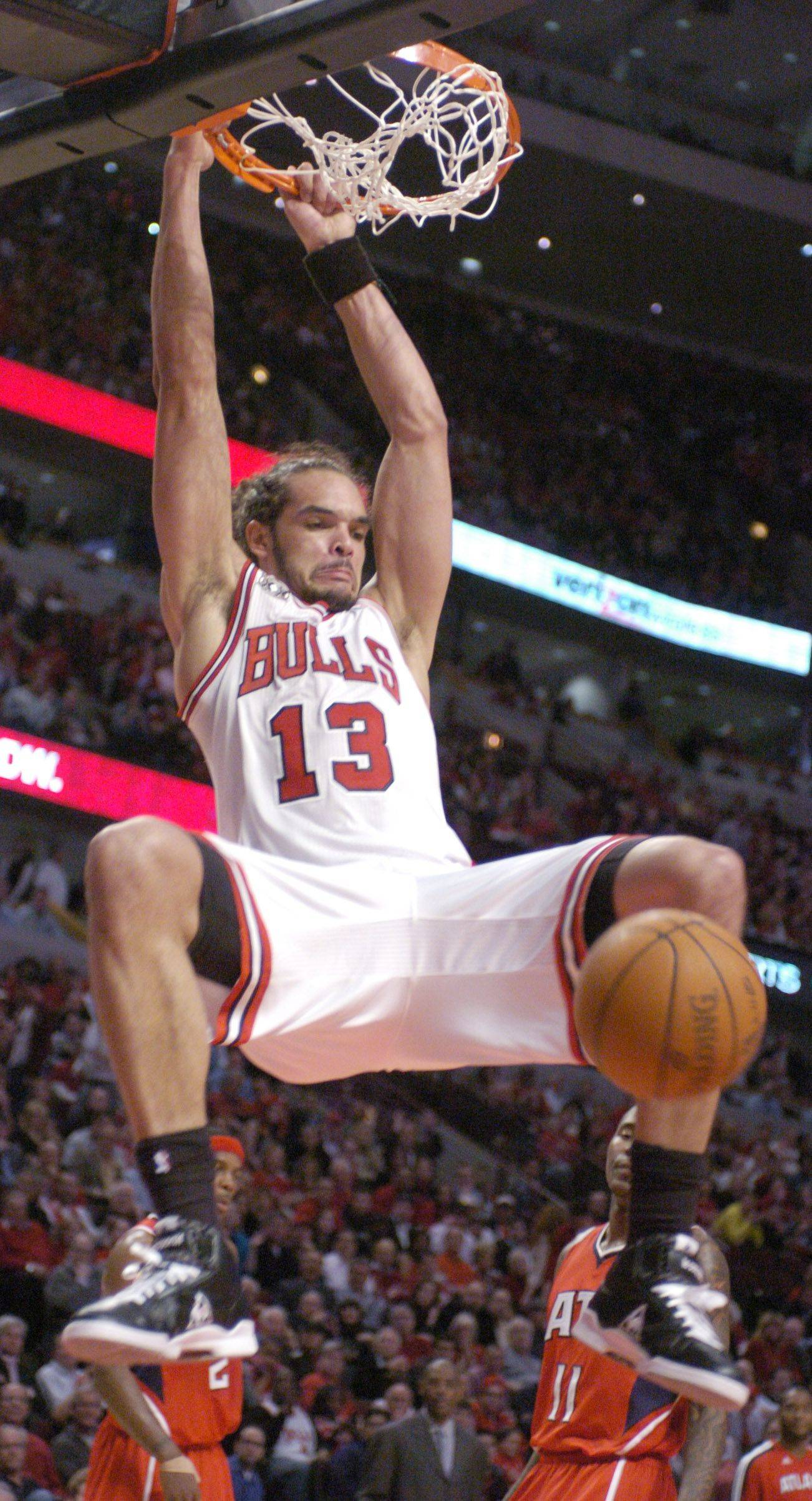 The Bulls' Joakim Noah hangs on the rim after dunking Wednesday's against the Hawks.