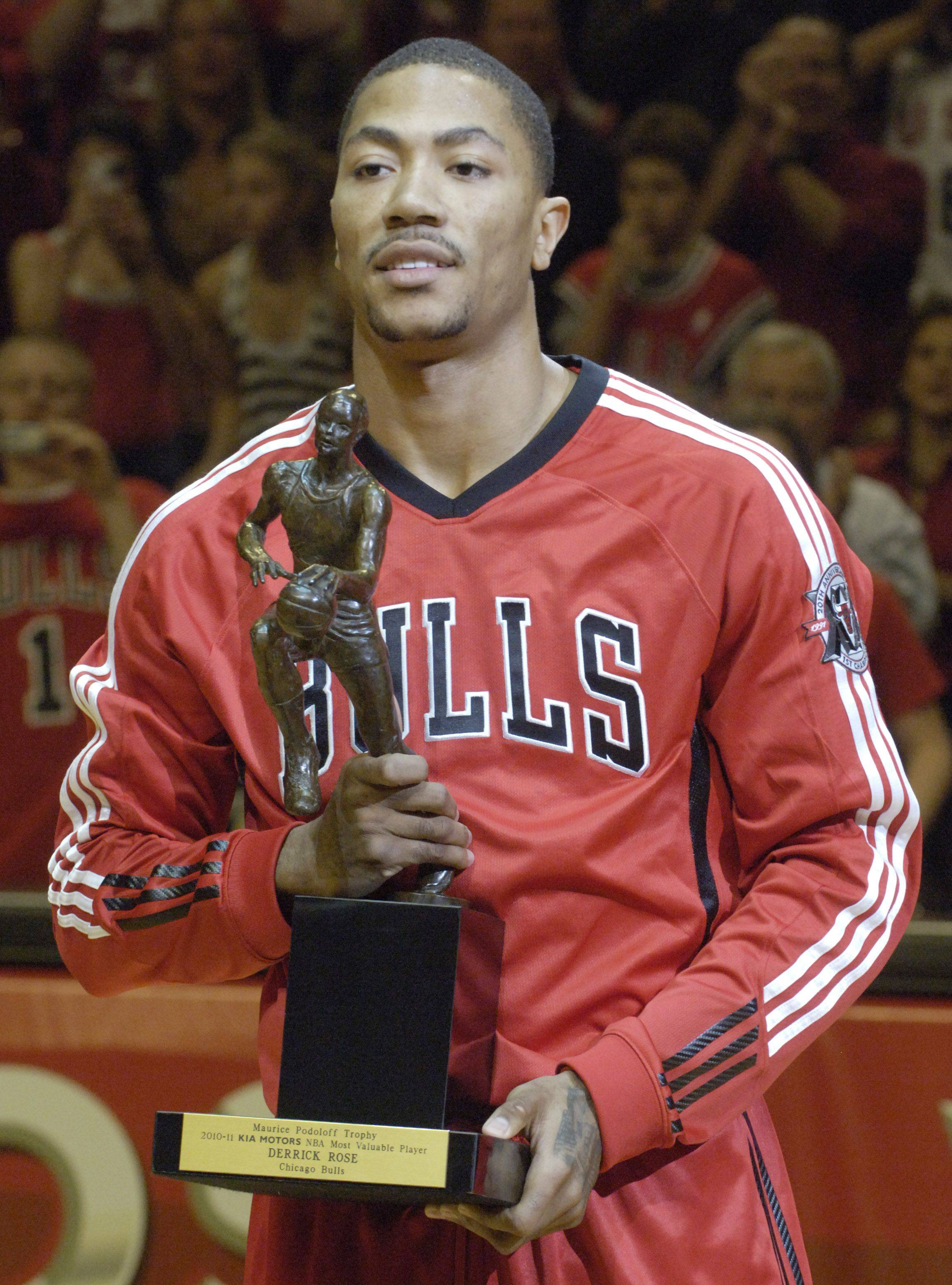 Derrick Rose of the Bulls holds the MVP trophy prior to Wednesday's game.