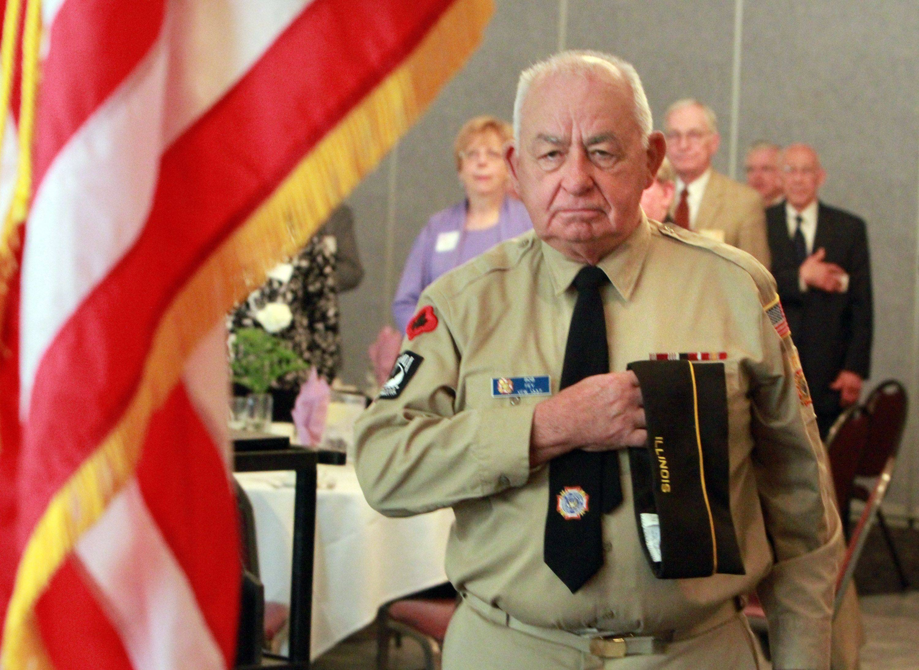Bob Fey of Mt. Prospect with VFW Post 1337 holds his hat over his hearts during the Pledge of Allegiance at the 12th Annual Mayor�s Prayer Breakfast at Bristol Court Banquets.