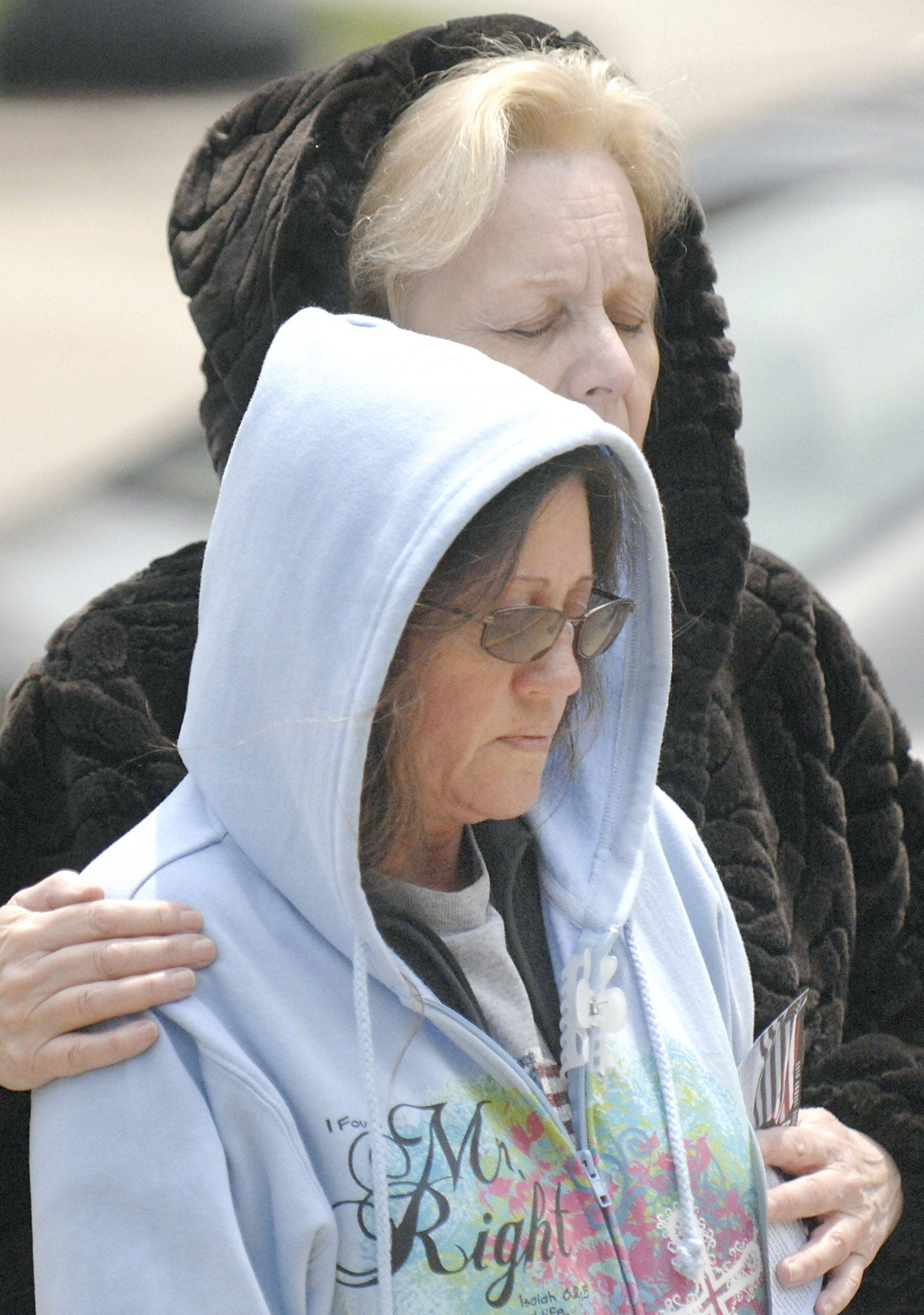 Sherry Koster, left, and Diane Erickson, both of Geneva, participate in the National Day of Prayer service held on the steps of the old Kane County Courthouse in Geneva on Thursday, May 5.