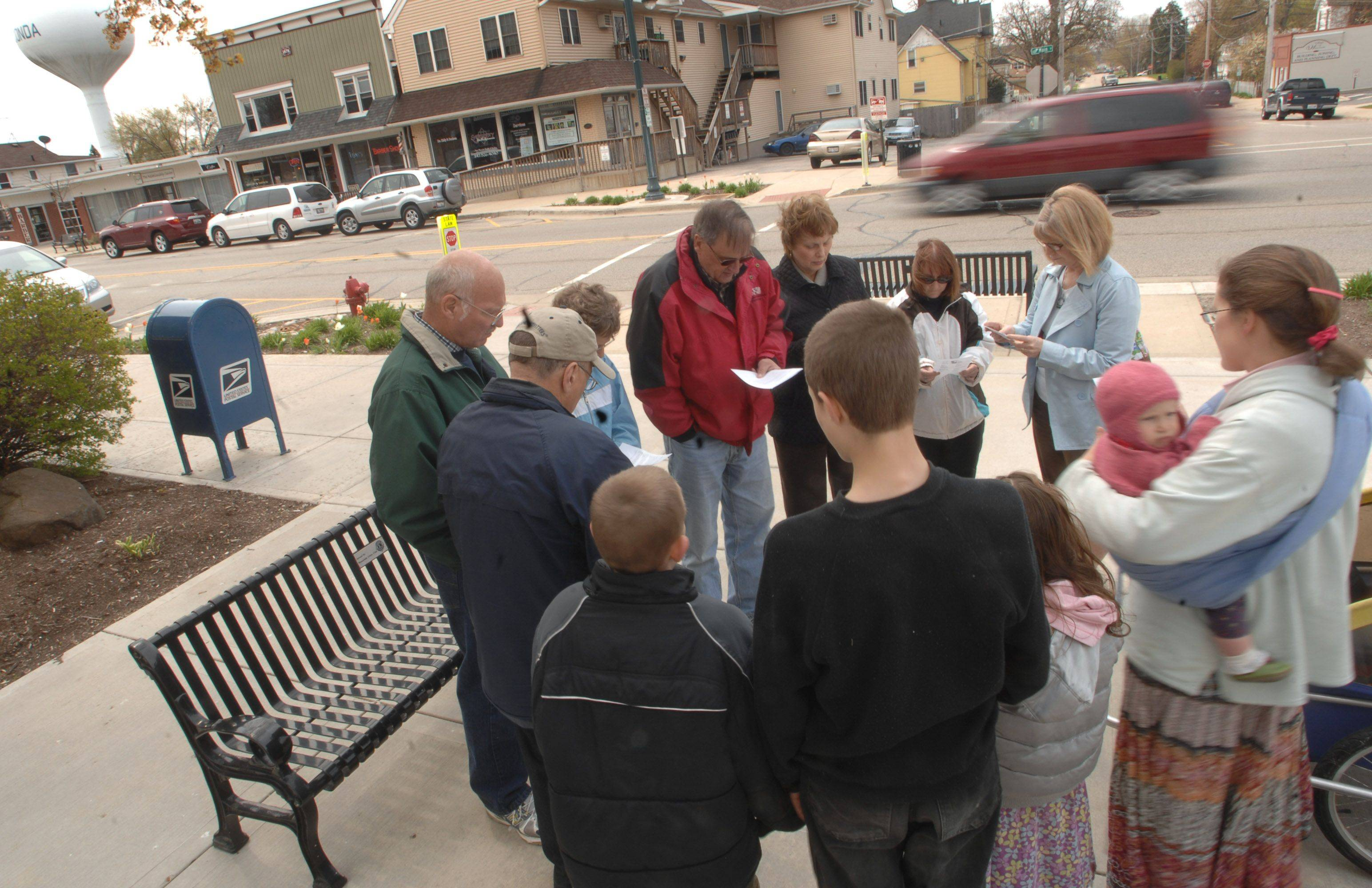 Around a dozen people gathered outside the Village of Wauconda Activity Center on Main Street Thursday to participate in the National Day of Prayer.