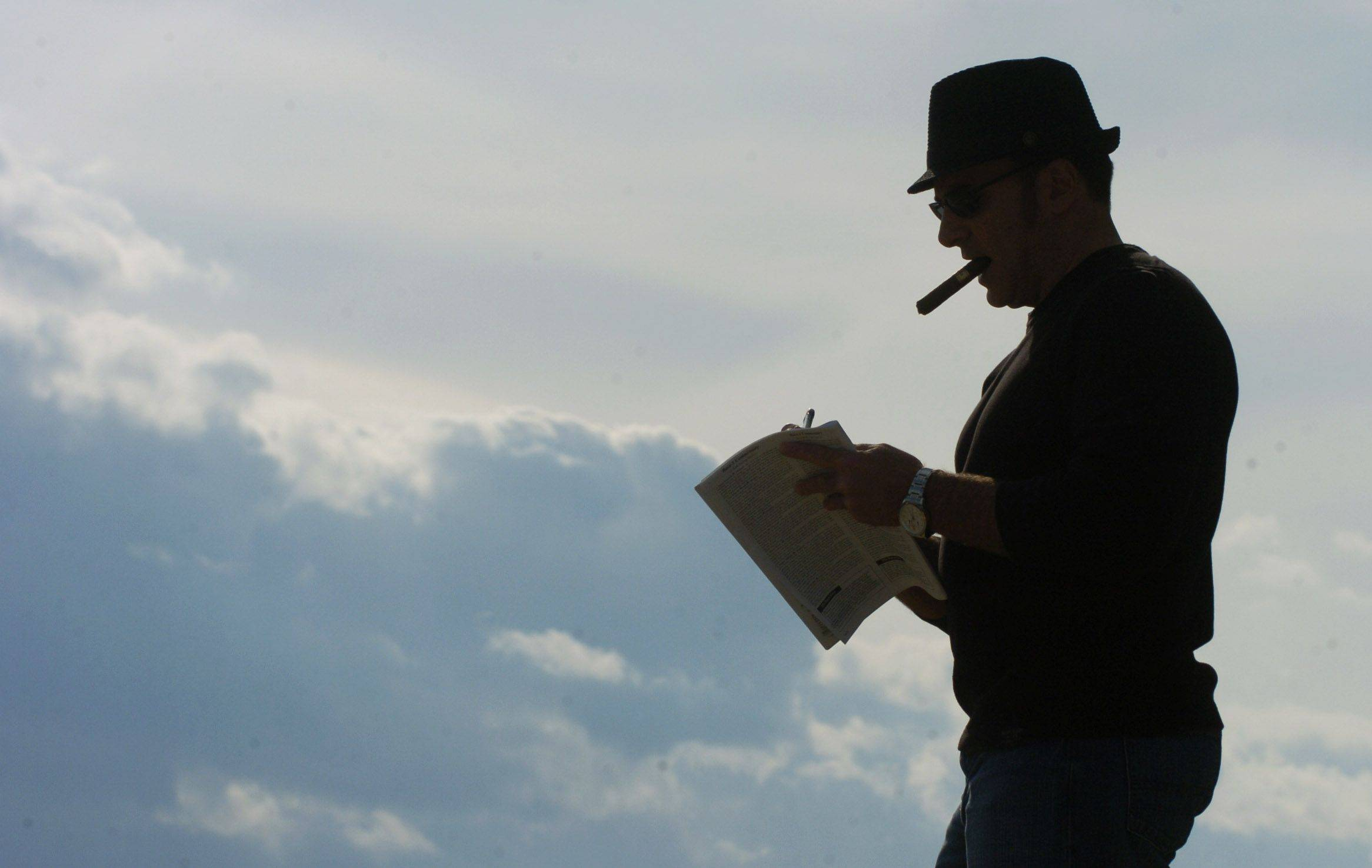 A fan checks his racing form on opening day at Arlington Park Friday.