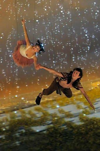 "Peter Pan (Ciaran Joyce) and Tinker Bell (Emily Yetter) soar in Threesixty Entertainment's dazzling high-tech production of ""Peter Pan."""