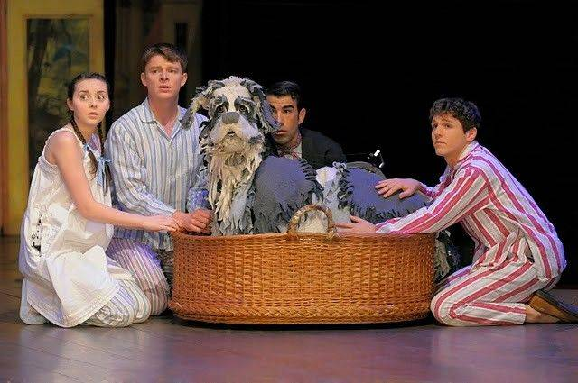 "Wendy (Evelyn Hoskins, left), John (Tom Larkin, second from left) and Michael (Scott Weston, right) defend their canine nurse Nana (Joshua Holden, second from right) from a parental scolding in Threesixty Entertainment's state-of-the-art adaptation of J.M. Barrie's ""Peter Pan."""