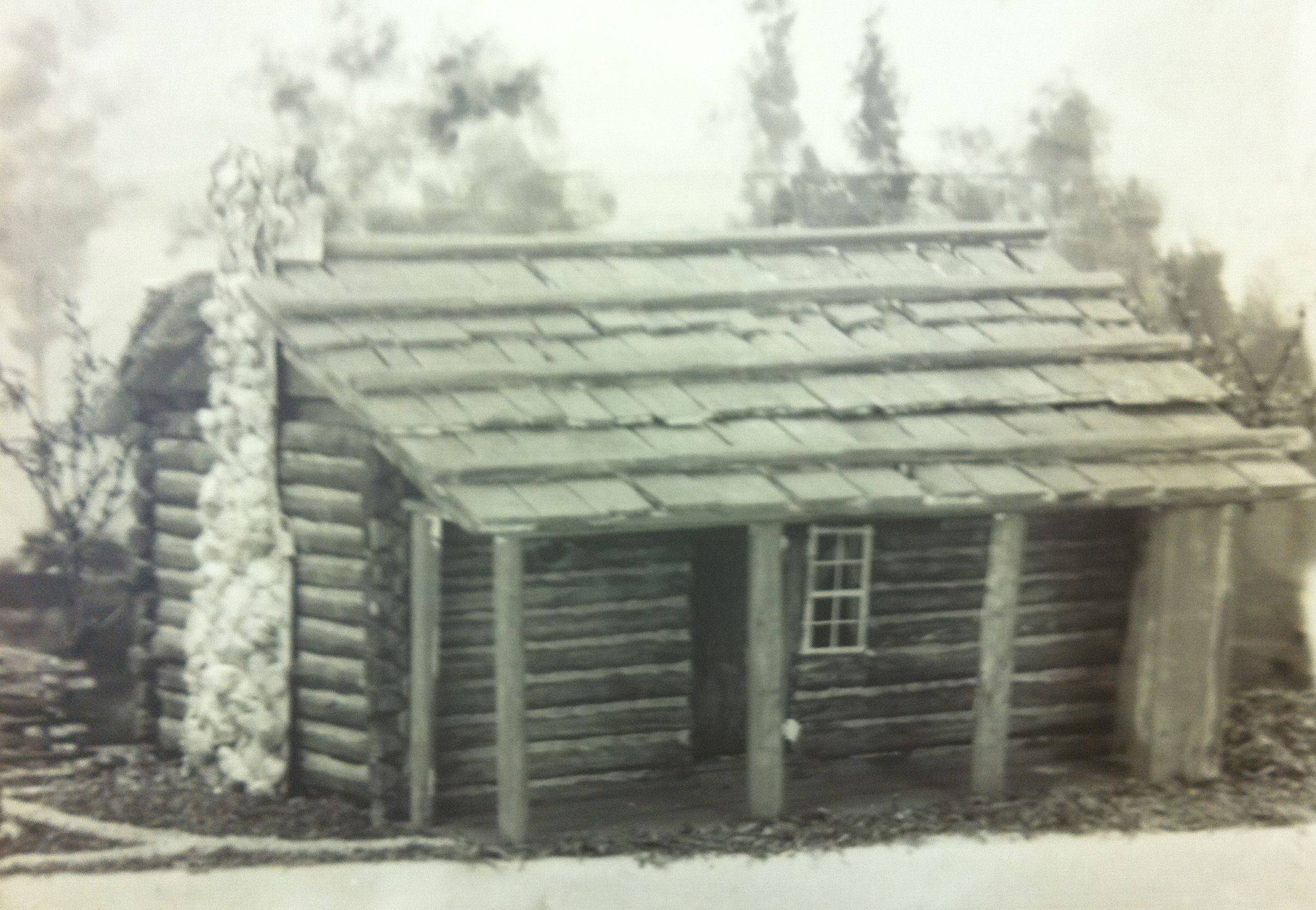 The home of James T. Gifford at Prairie and Villa streets as it was described by his widow and other pioneers. First Congregational Church was organized in this cabin and used it as a meeting place for its first three years.