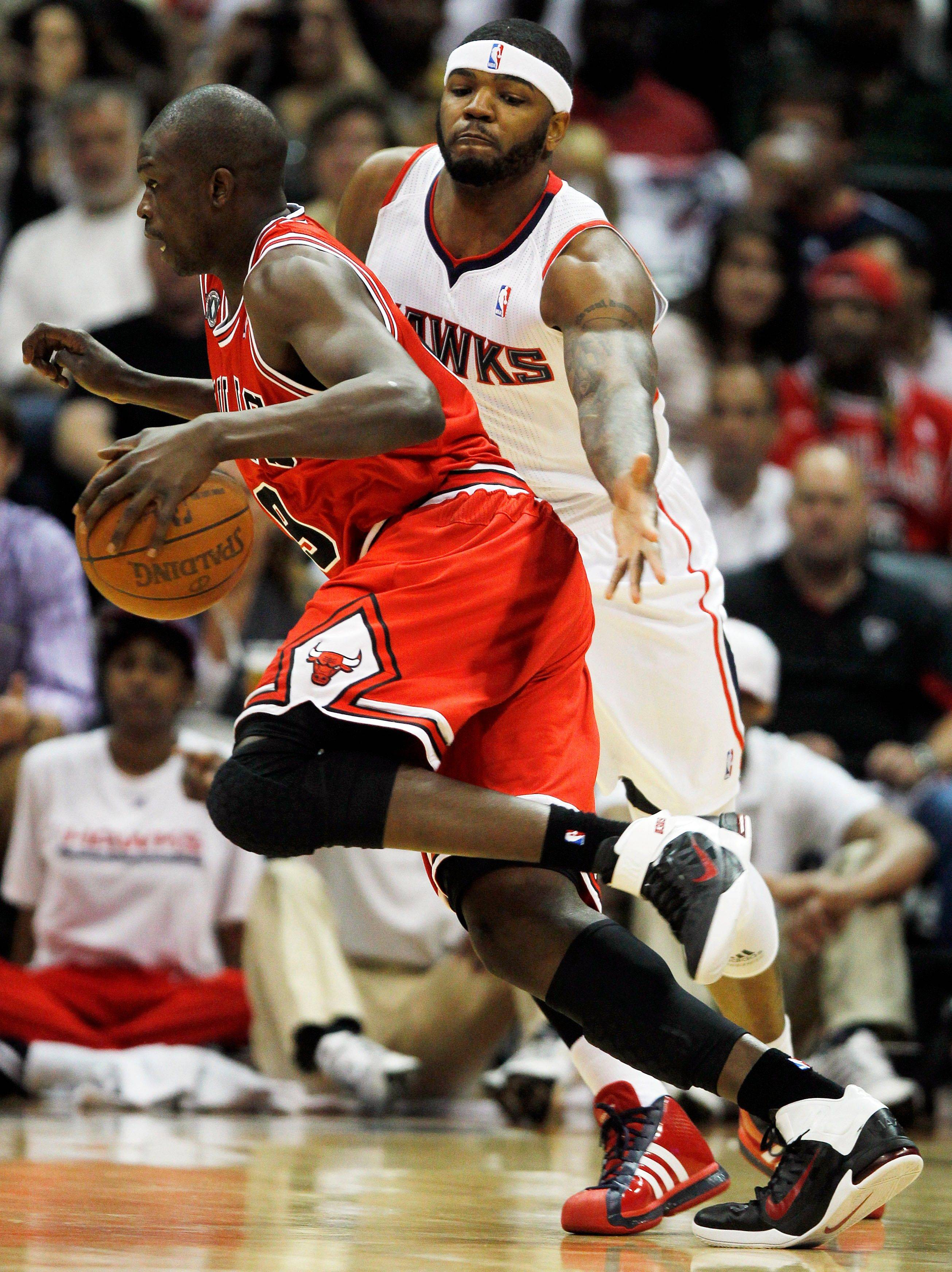 Luol Deng (9) drives past Atlanta Hawks power forward Josh Smith (5) in the first quarter of Game 4.