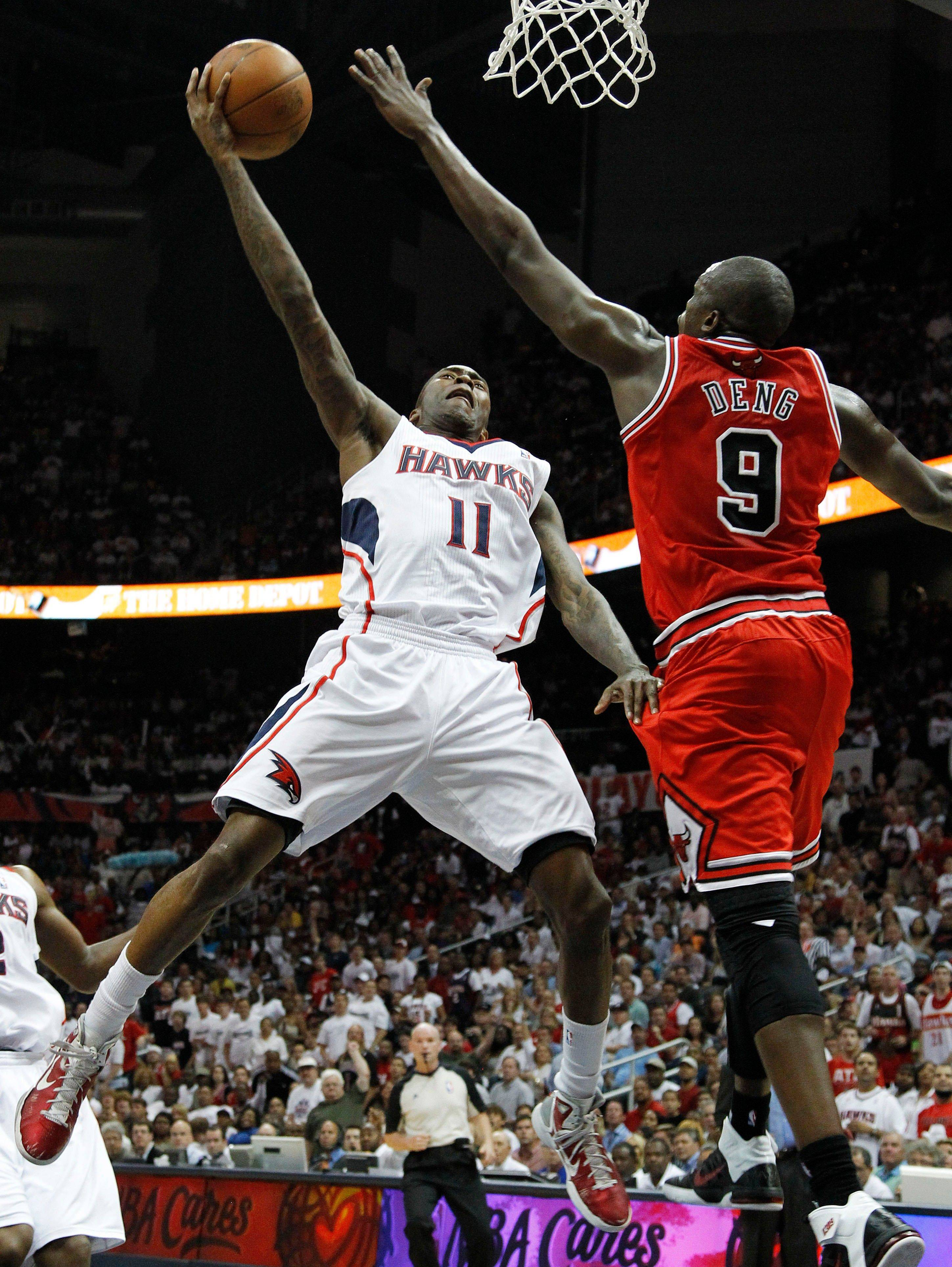 Atlanta Hawks guard Jamal Crawford (11) shoots as Luol Deng (9) defends in the first quarter.