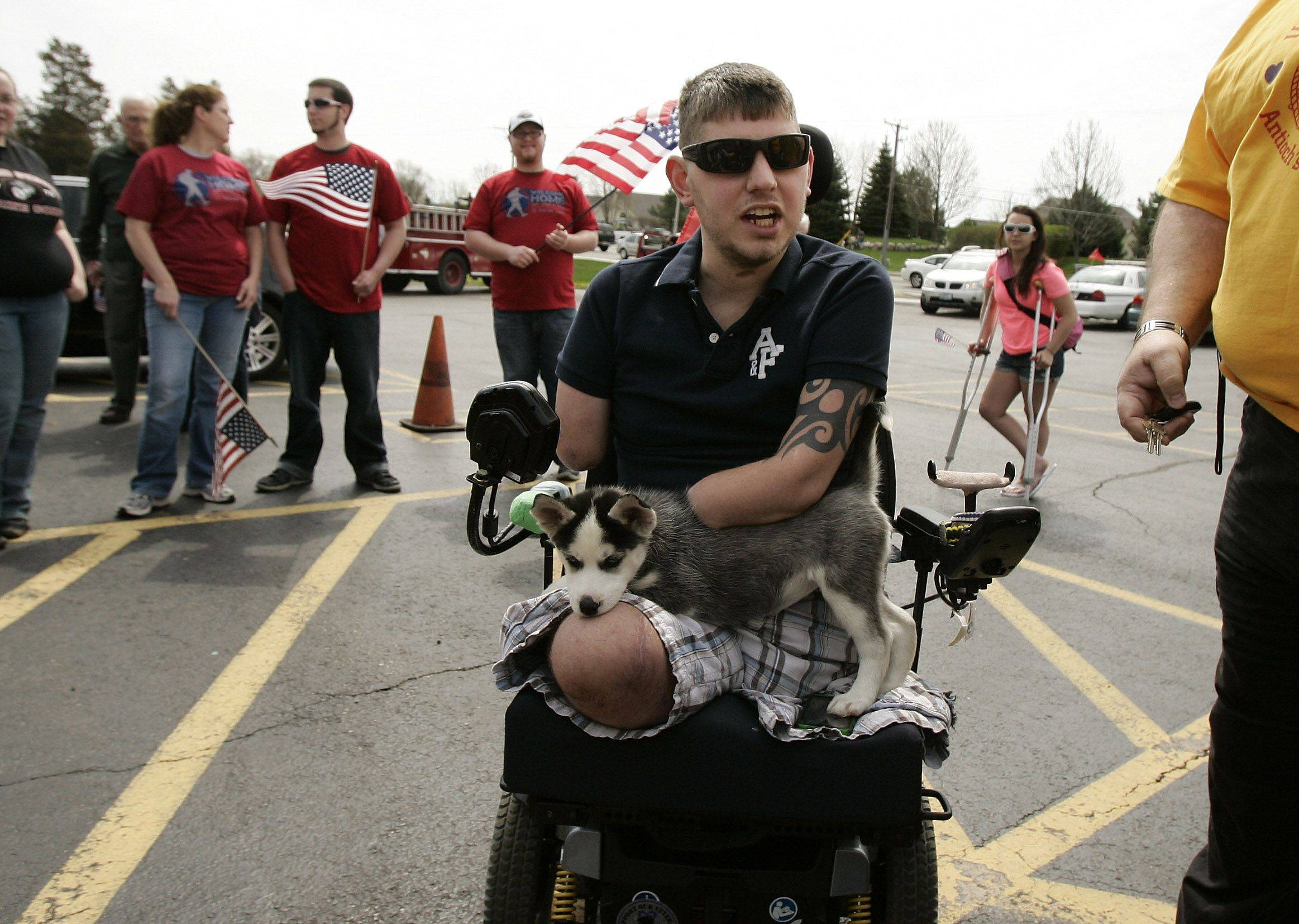 U.S. Marine Cpl. John Peck arrives Monday at VFW Post 4551 after a motorcade in his honor. Peck lost his limbs in Afghanistan last year after stepping on an explosive device.