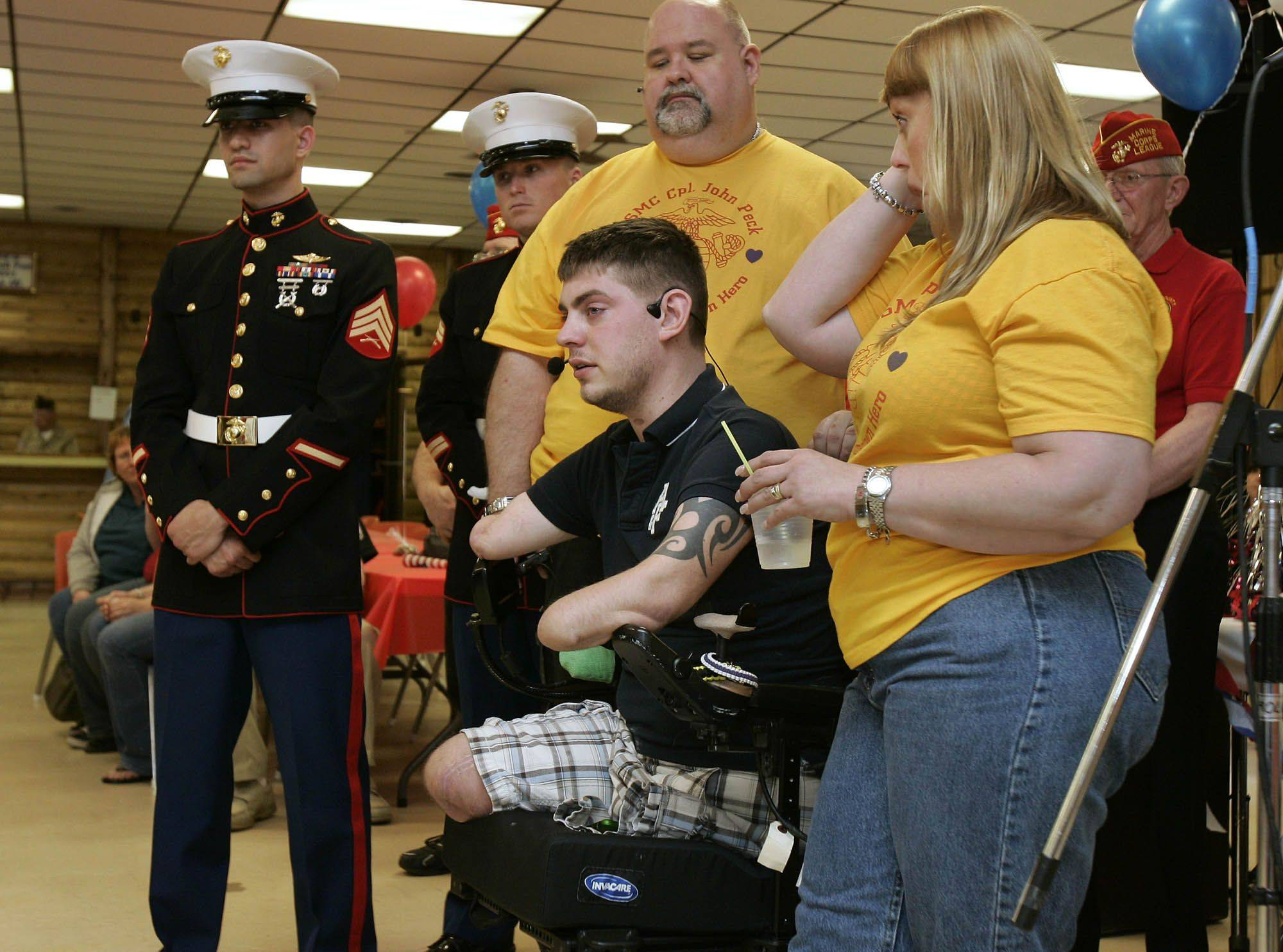 U.S. Marine Cpl. John Peck talks about dead buddies and thanks his supporters Monday at the VFW hall in Antioch.