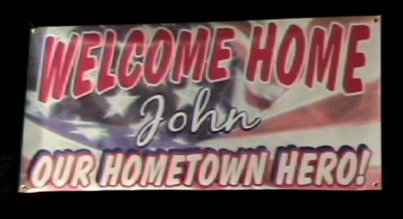 A welcome home sign for U.S. Marine Sgt. John Peck who was honored in Antioch Monday with a parade and a celebration at the Antioch VFW Hall.