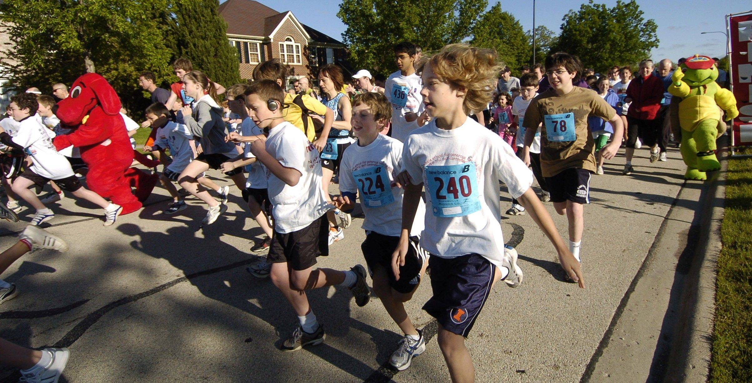 Runners take off in the 2009 Jeanine Nicarico Run for Reading. Organizers of the Naperville fundraiser hope to draw a record-breaking crowd for its 10th race on Sunday, May 15.