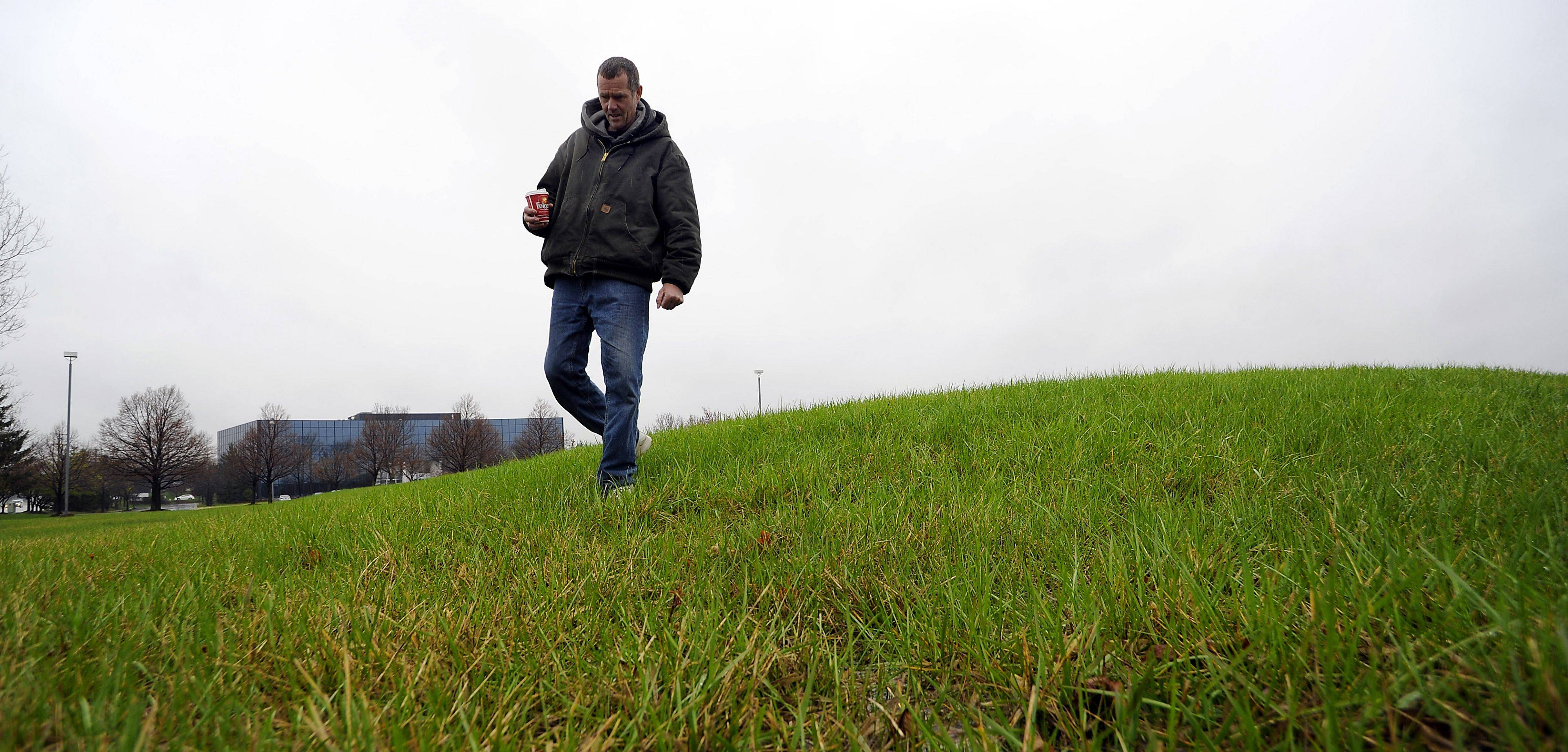 Rolling Meadows resident Tom Hahn walks on the American Indian mound his research rediscovered along Algonquin Road in Schaumburg.