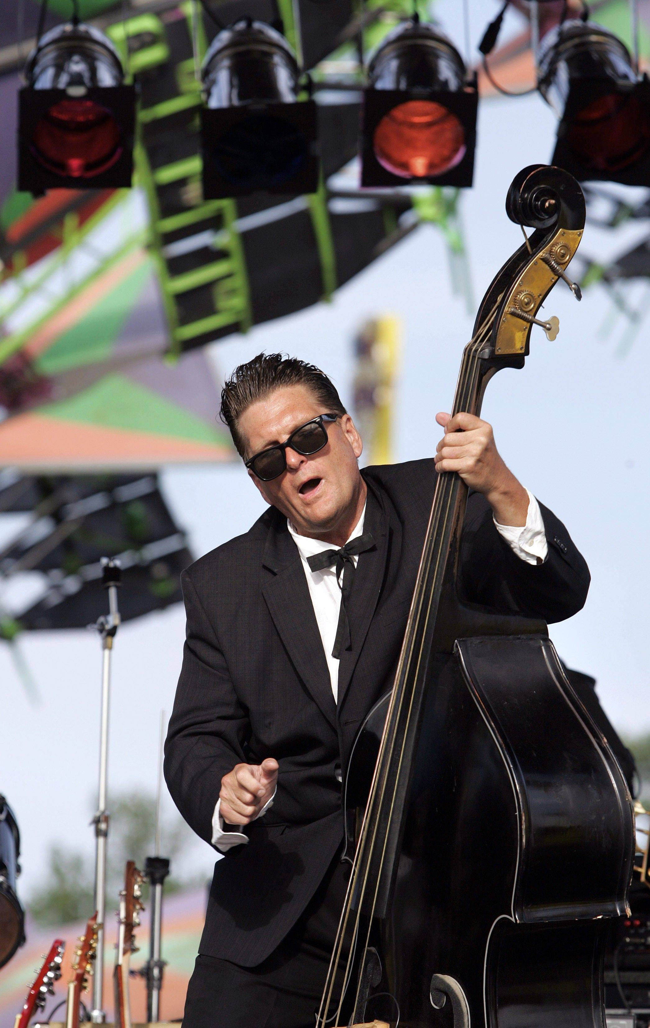 Craig Gigstad of The Neverly Brothers plays his bass at an outdoor festival. The Neverly Brothers will play a free show Sunday, June 26, at Geneva Commons.