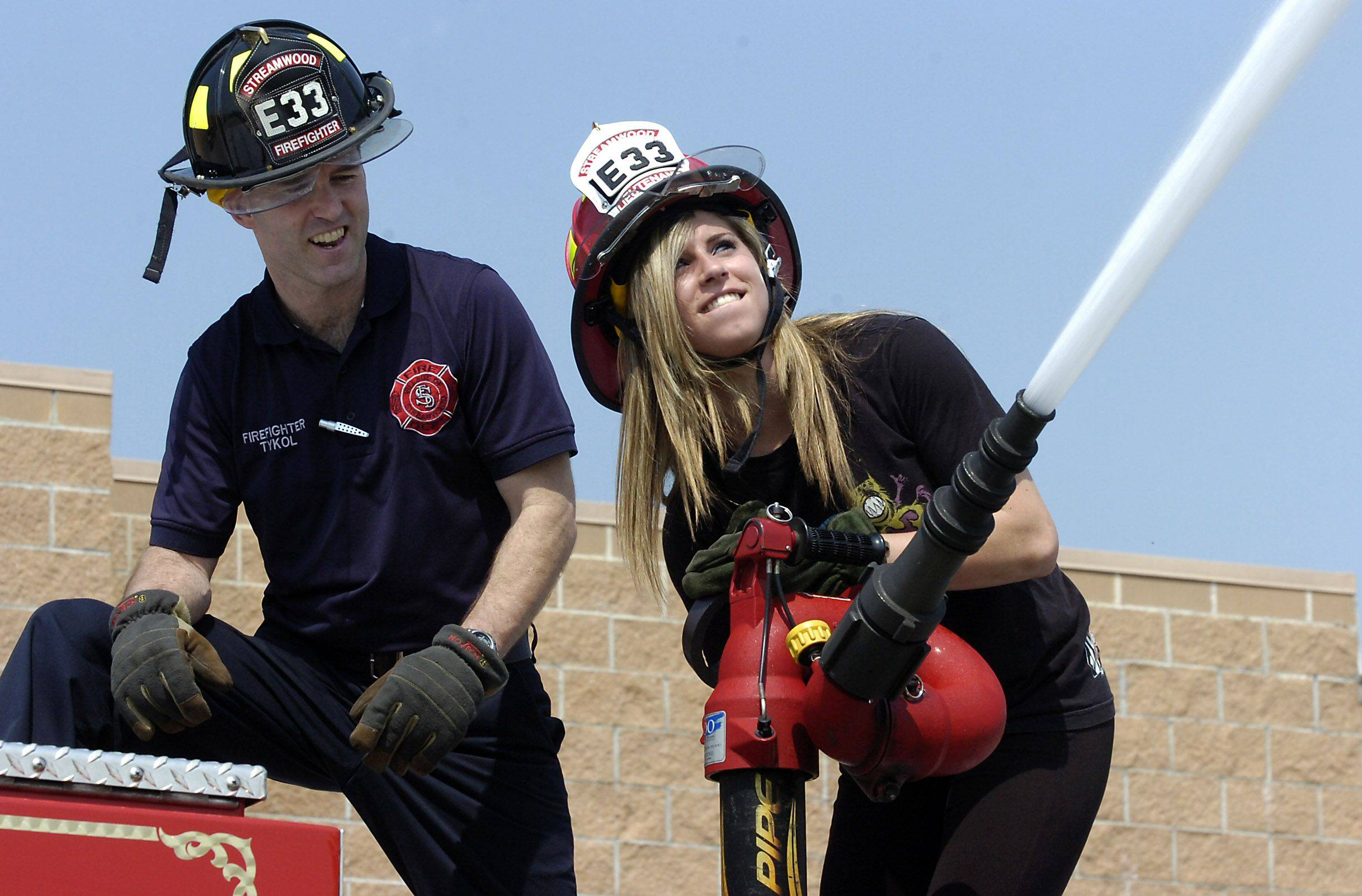 Streamwood High School senior Brianna Bogdajewicz, 18, shadows firefighter John Tykol Wednesday during the school's 30th annual Student Government Day.