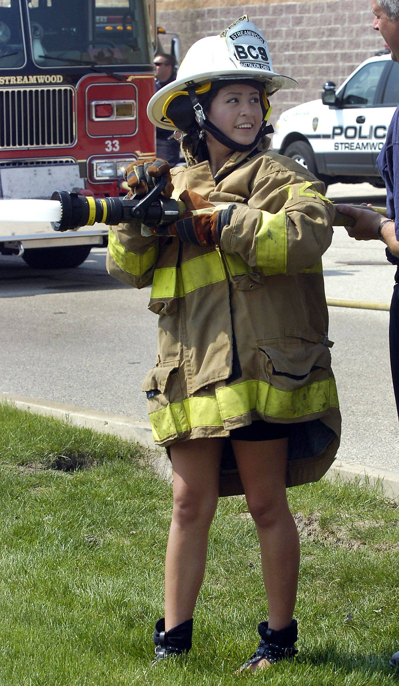 Streamwood High School senior Rosa Morales, 17, learns about the Streamwood fire department Wednesday during the school's 30th annual Student Government Day.
