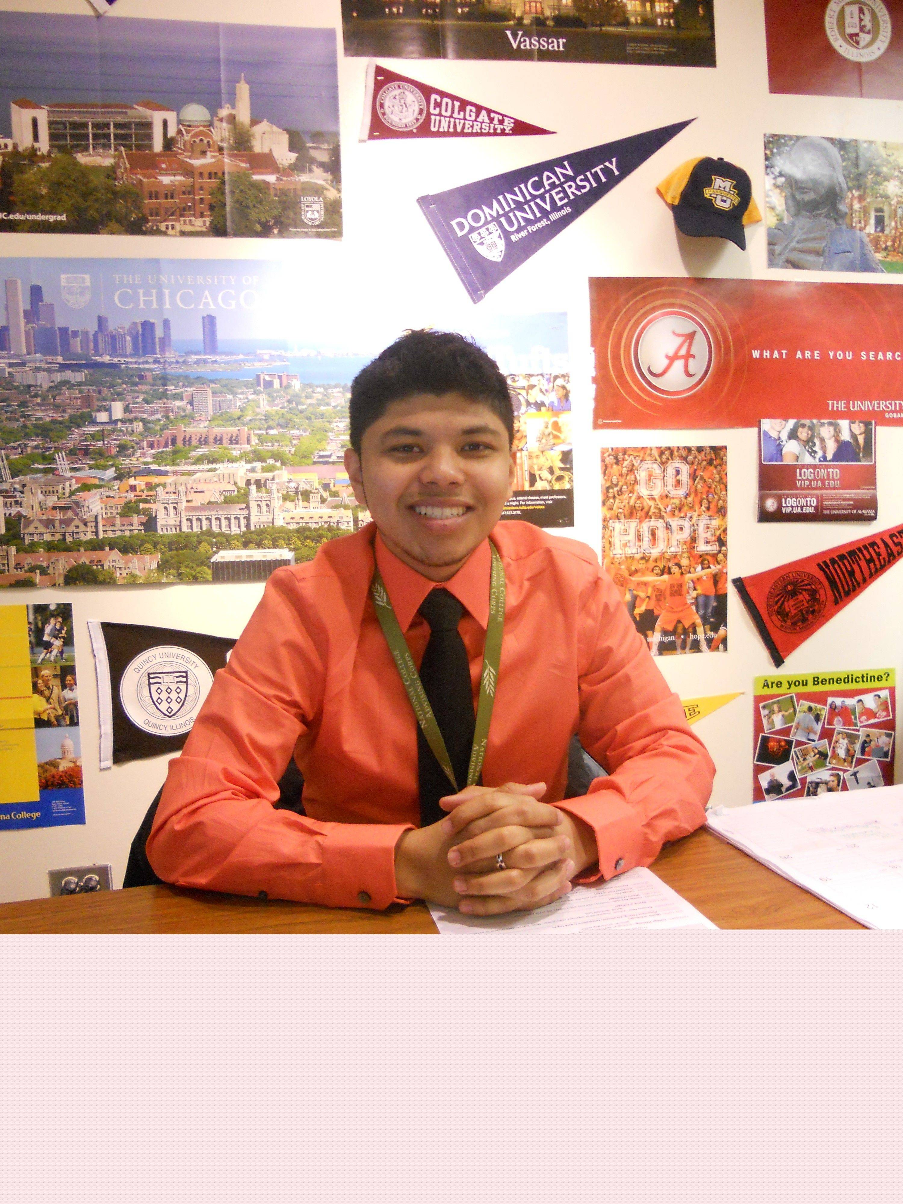 Round Lake High School college adviser Rodrigo Lopez is one of the leaders of Friday's Decision Day for selected seniors. It'll be a celebration for seniors with education plans involving college or the armed forces.