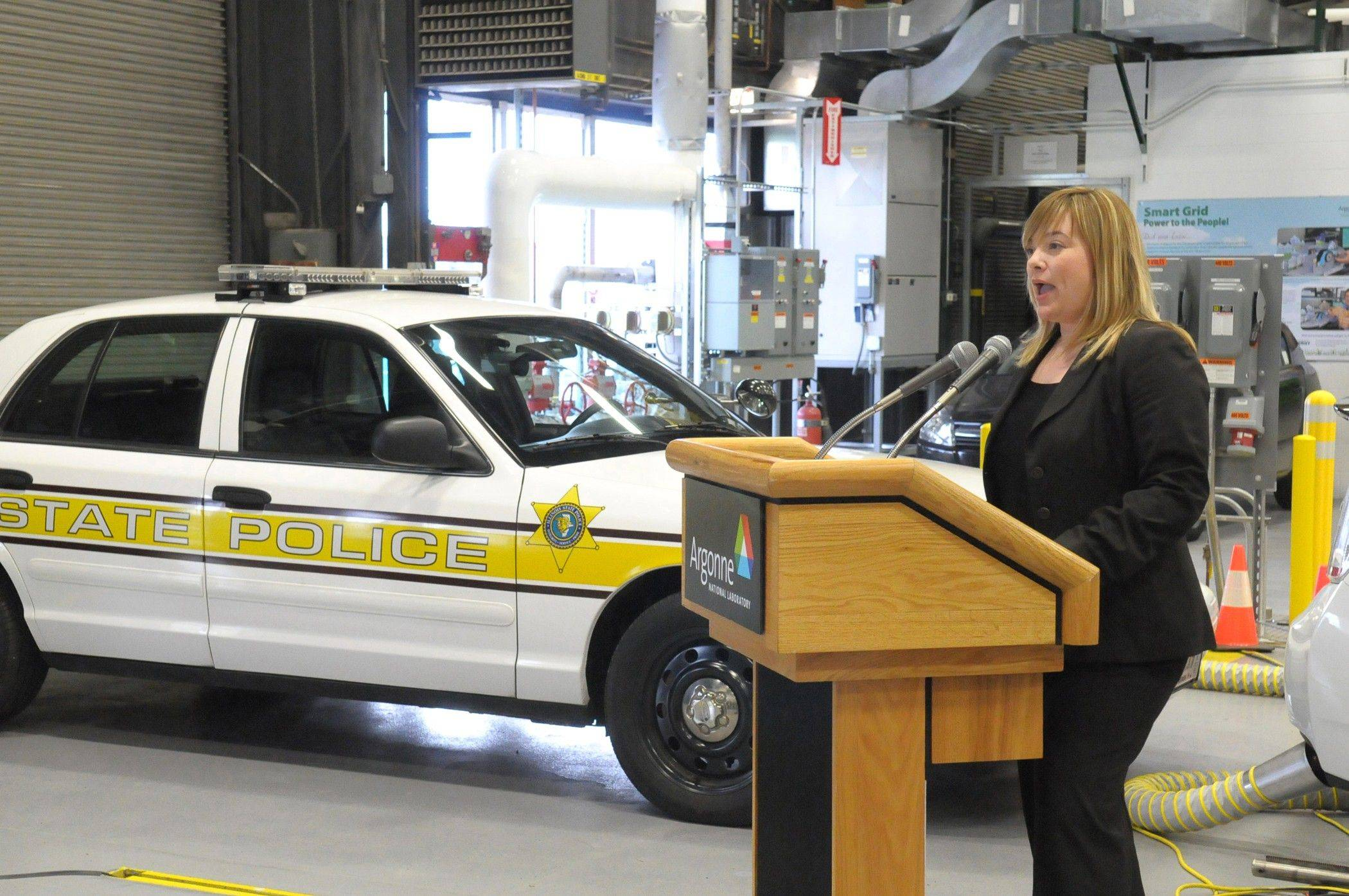 Illinois State Toll Highway Authority Executive Director Kristi Lafleur talks about the agency's partnership with Argonne National Laboratory. A State Police squad car will be tested by scientists at Argonne's Transportation Research Center for ways to increase fuel efficiency, such as reduced idling.