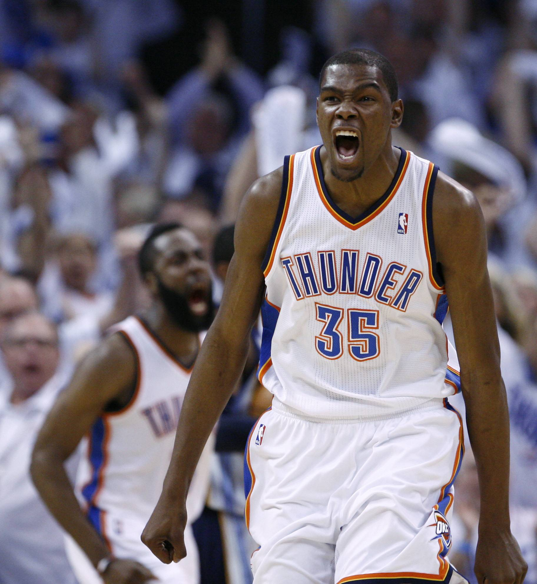 Kevin Durant, right, reacts to a dunk by teammate James Harden, left, in the second quarter of Game 5.
